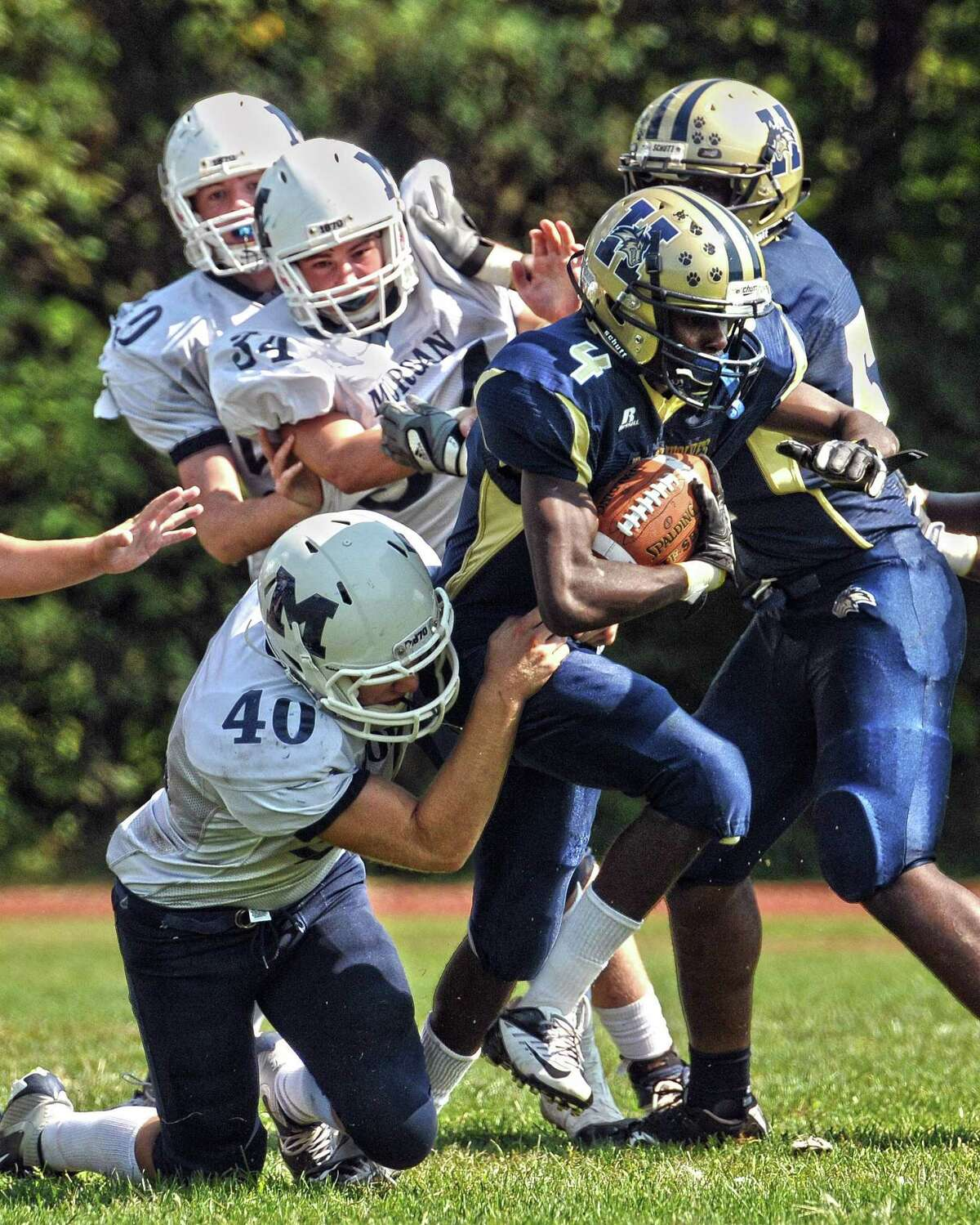 Morgan's Nick Sneider makes a tackle earlier this season against Hyde. Morgan closed its season with a win over Old Saybrook/Westbrook. Photo Peter Casolino/New Haven Register