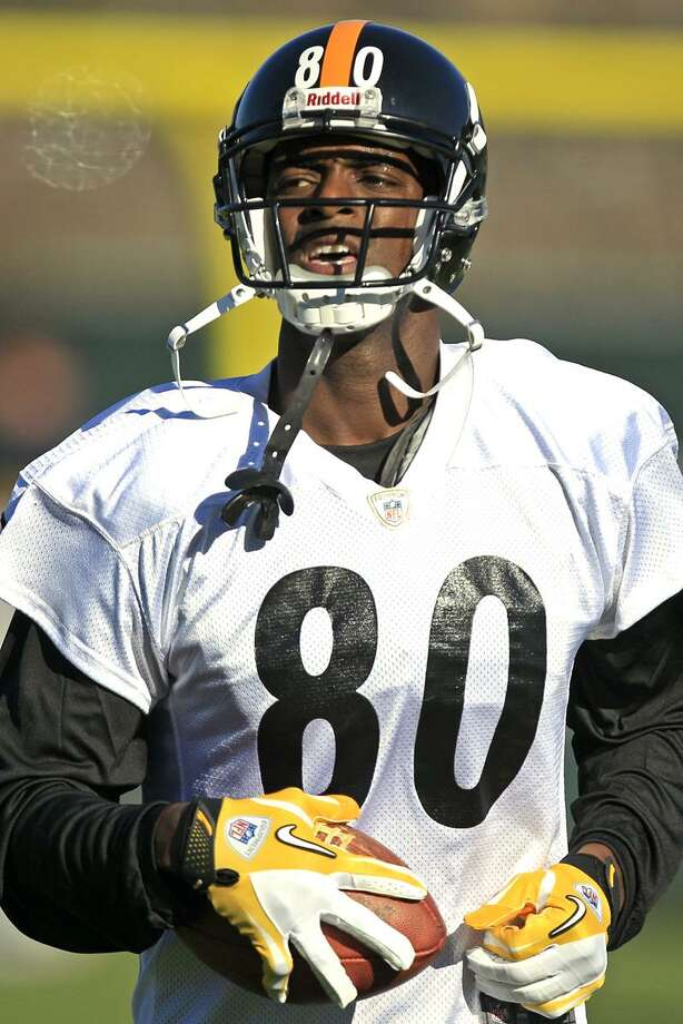 Newly signed Pittsburgh Steelers wide receiver Plaxico Burress (80) runs a drill during NFL football practice, Wednesday, Nov. 21, 2012, in Pittsburgh. Burress returned to the team that drafted him a dozen years ago on Wednesday hungry, humble and eager to prove there's still some life left in a career that's never quite lived up to his own outsized expectations. (AP Photo/Gene J. Puskar) Photo: AP / AP2012