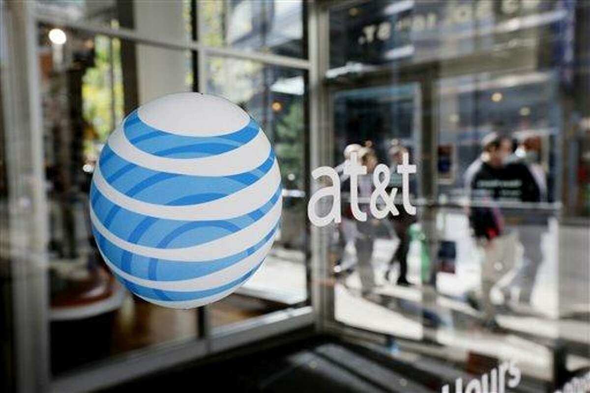 An AT&T logo is displayed on an AT&T Wireless retail store front in Philadelphia. Associated Press file photo