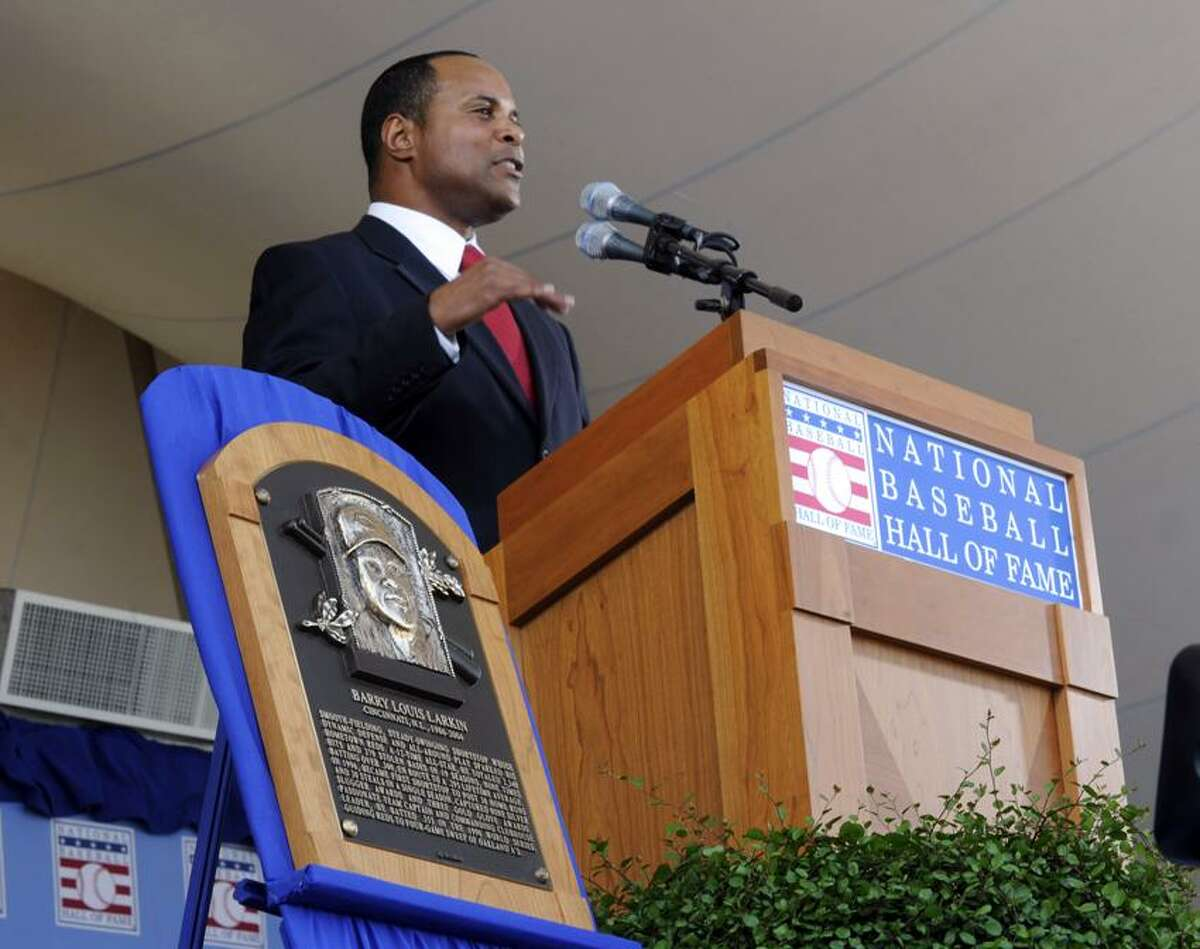 Former Cincinnati Reds star Barry Larkin speaks during his induction into the National Baseball Hall of Fame and Museum, Sunday, July 22, 2012, in Cooperstown, N.Y. (AP Photo/Tim Roske)