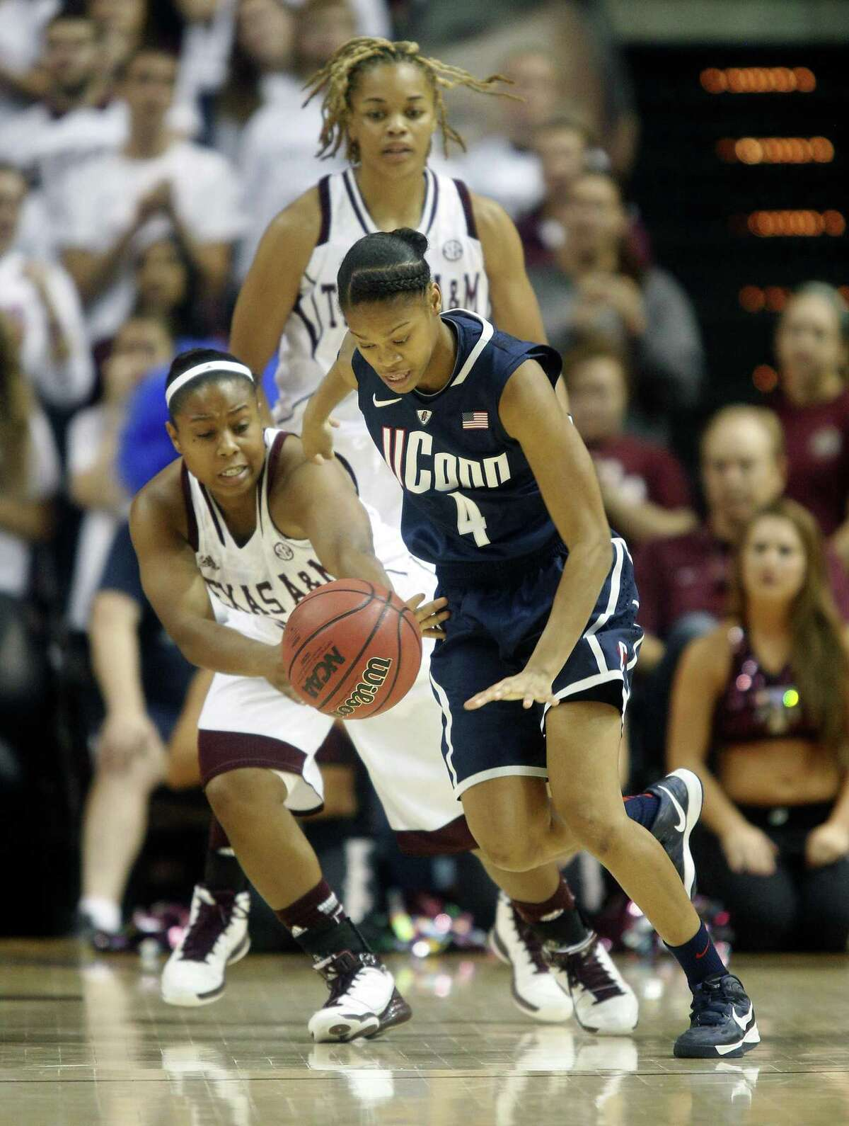 Texas A&M's Adrienne Pratcher attempts to steal the ball from Connecticut 's Moriah Jefferson during the second half of the Nov. 18, 2012 game in College Station, Texas. Connecticut won 81-50. Photo by The Associated Press