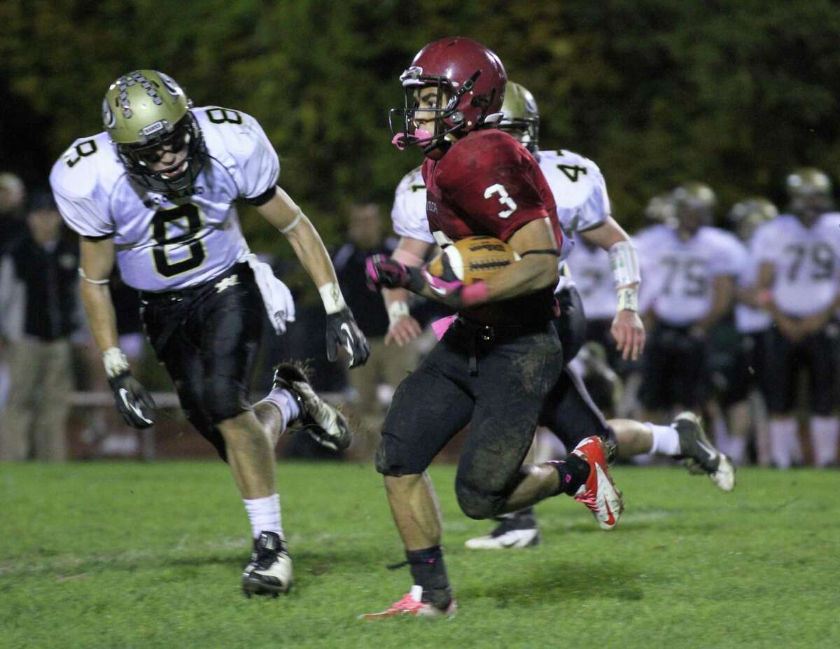 Torrington's Joan Toribio (#3) runs for a gain of 39 yards in the Raiders loss to Woodland October 20th.