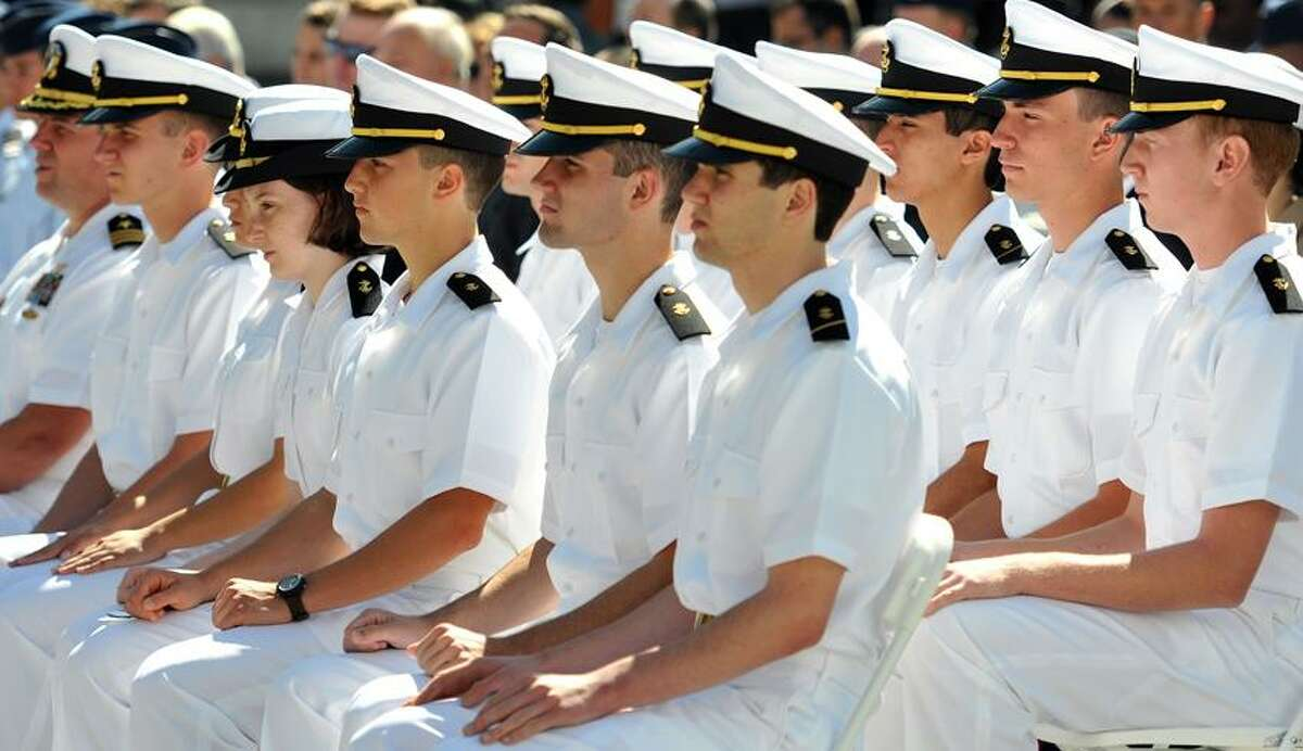 New Haven-- Navy Cadets listen to speeches at the ceremony on Yale's Hewitt Quadrangle marking the return of the Air Force and Naval Reserve Officers Training Corps (ROTC) on the Yale campus. Photo Peter Casolino/New Haven Register