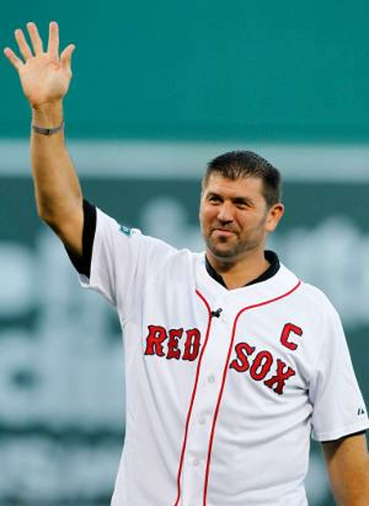 ASSOCIATED PRESS Former Boston Red Sox player Jason Varitek waves to the crowd during a ceremony to honor his time with the team before Saturday's night game between the Red Sox and Toronto Blue Jays at Fenway Park in Boston.