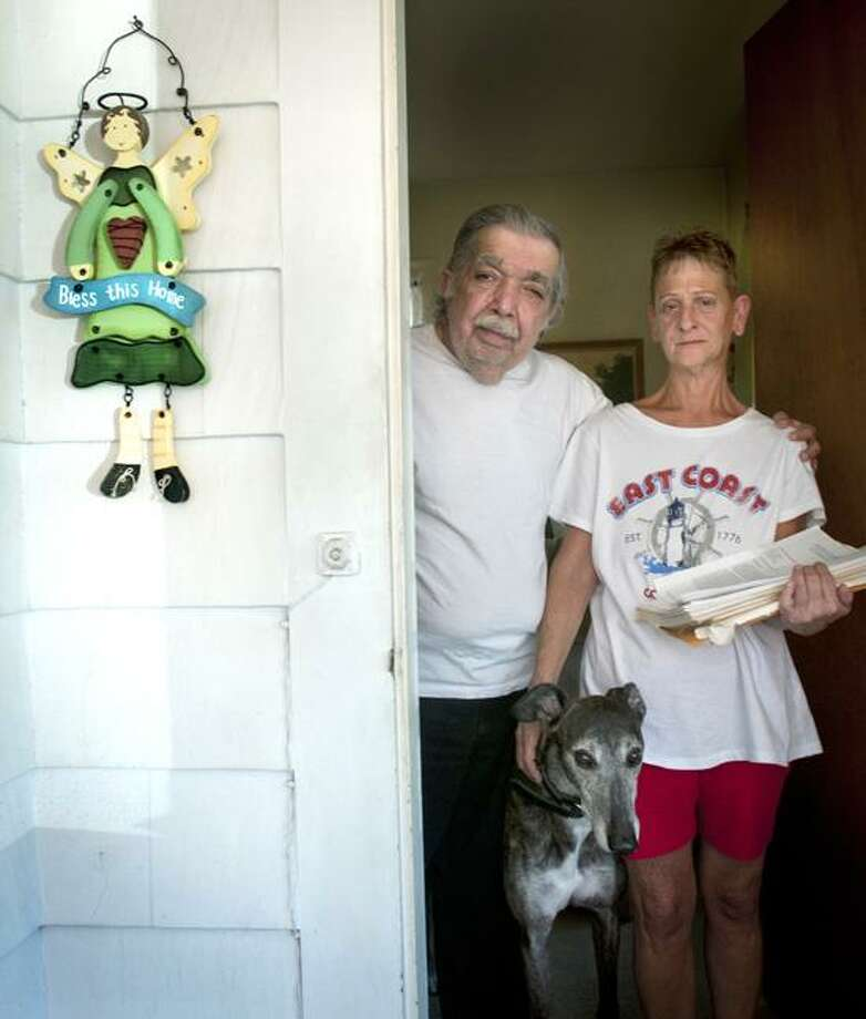 WEST HAVEN George (L) and Ronnie Mandell in the doorway of their West Haven home. They would not accept a Bank of America remortgaging proposal because it contained a gag order, and the promise not to retain legal council.   Melanie Stengel/Register