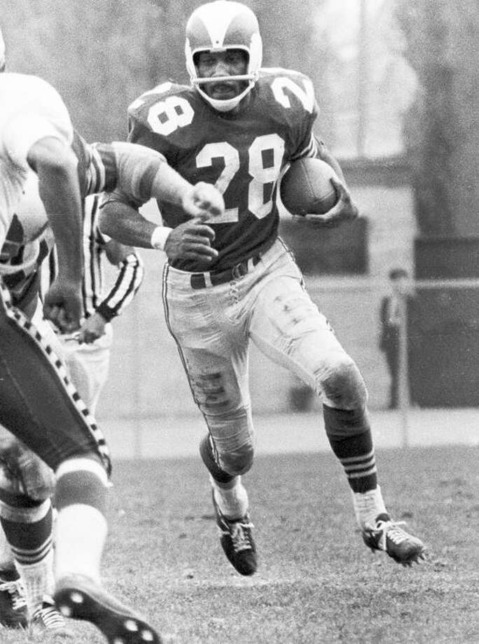 Photo courtesy of the Montreal Alouettes George Dixon picks up some of the 1,270 yards he gained for the Montreal Alouettes in 1963. / scottgrantis@rogers.com
