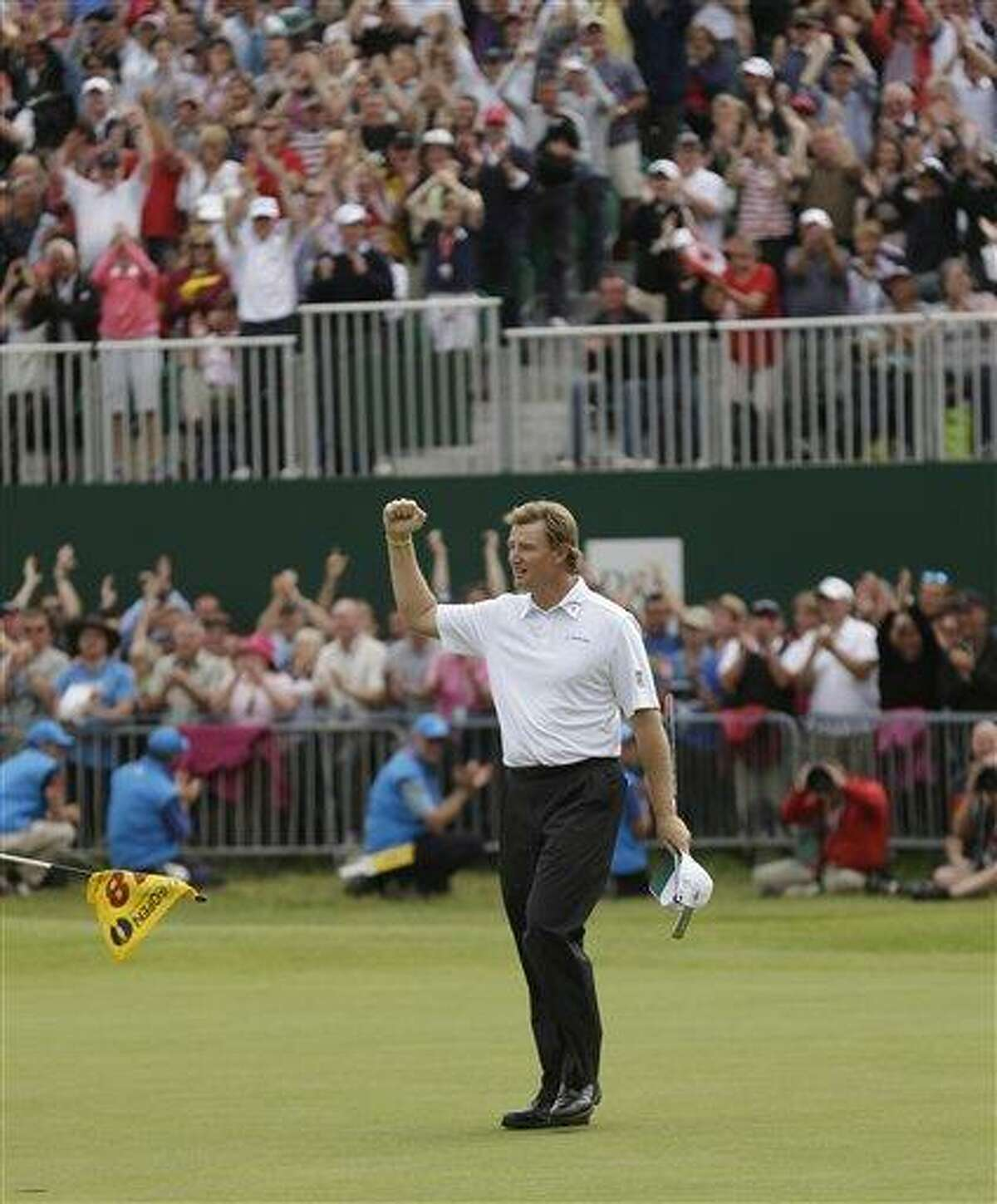 Ernie Els of South Africa reacts after putting on the 18 green at Royal Lytham & St Annes golf club during the final round Sunday of the British Open Golf Championship, in Lytham St Annes, England. Associated Press