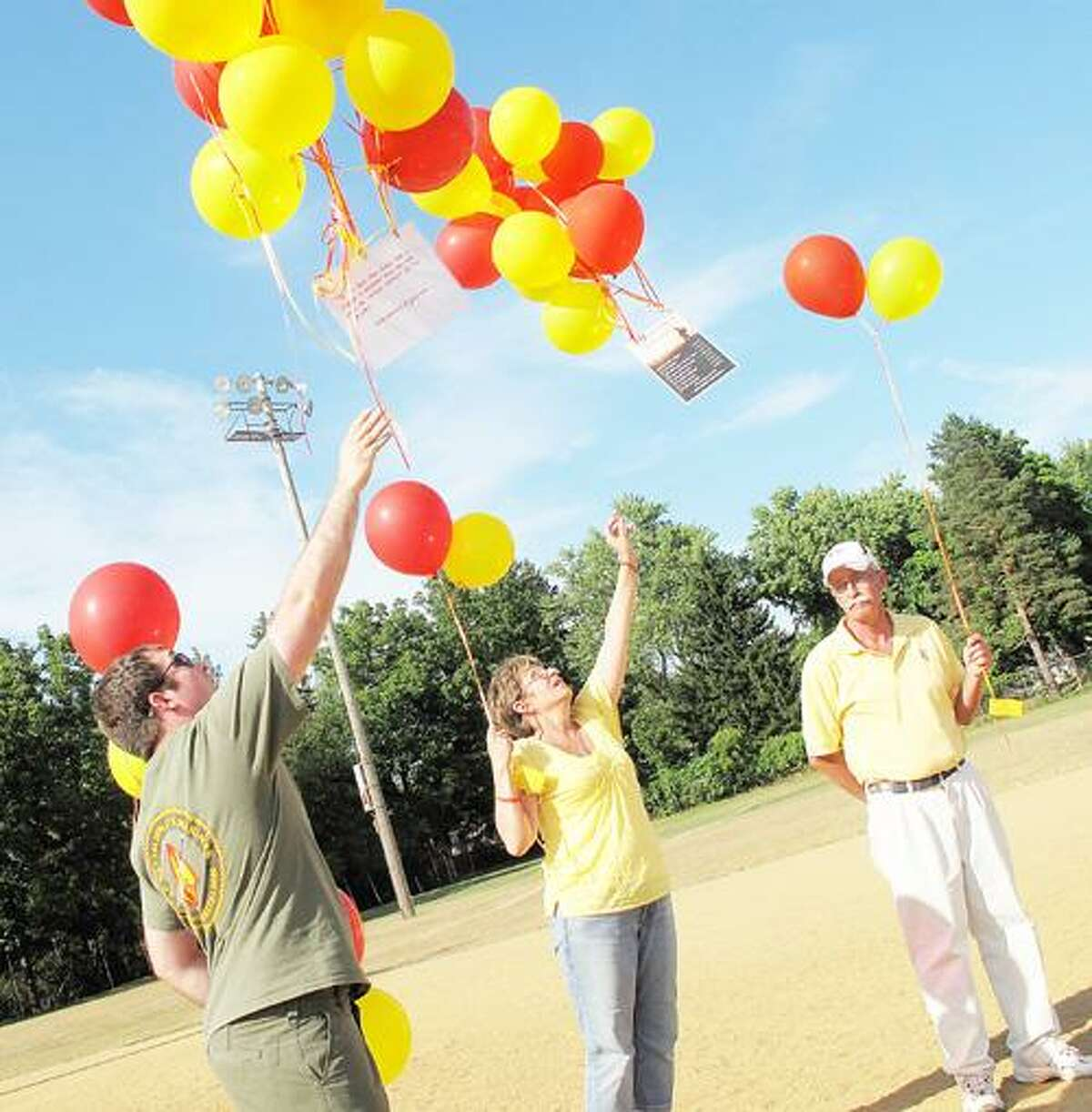 Dispatch Staff Photo by JOHN HAEGER (Twitter.com/OneidaPhoto) Vicky Arnold,center, and Kyle Castle release balloons on Saturday in Oneida in remembrance of Lance Cpl. Jeremy Lasher and fellow U.S. Marines who were killed in the line of duty. Lasher was killed in action in Afghanistan July 23, 2009.