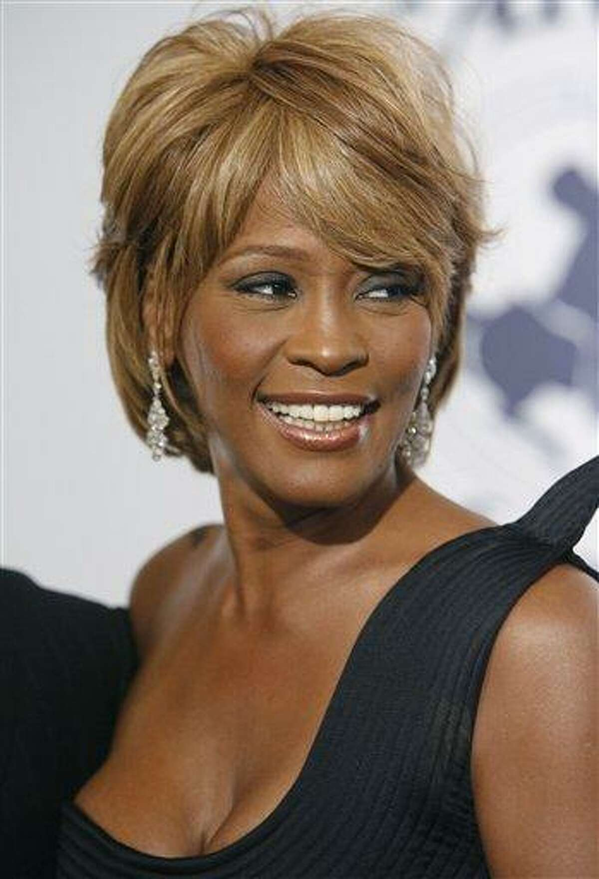 FILE - In this Oct. 28, 2006, file photo, musician Whitney Houston arrives at the 17th Carousel of Hope Ball benefiting the Barbara Davis Center for Childhood Diabetes in Beverly Hills, Calif. Coroner's officials said Thursday, March 22, 2012, that Houston drowned, but her death was also caused by heart disease and cocaine use that suggested she was chronically using the drug. Houston died Feb. 11, in California at the age of 48. (AP Photo/Matt Sayles)