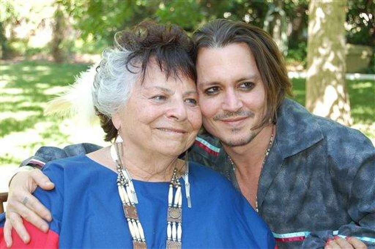 This photo provided by Americans for Indian Opportunity shows LaDonna Harris, left, president of Americans for Indian Opportunity, poses with actor Johnny Depp at her Albuquerque, N.M., home on May 16, 2012. Harris invited Depp to become an adopted member of the Comanche Indian tribe in a private ceremony. Depp is currently filming the role of Tonto in
