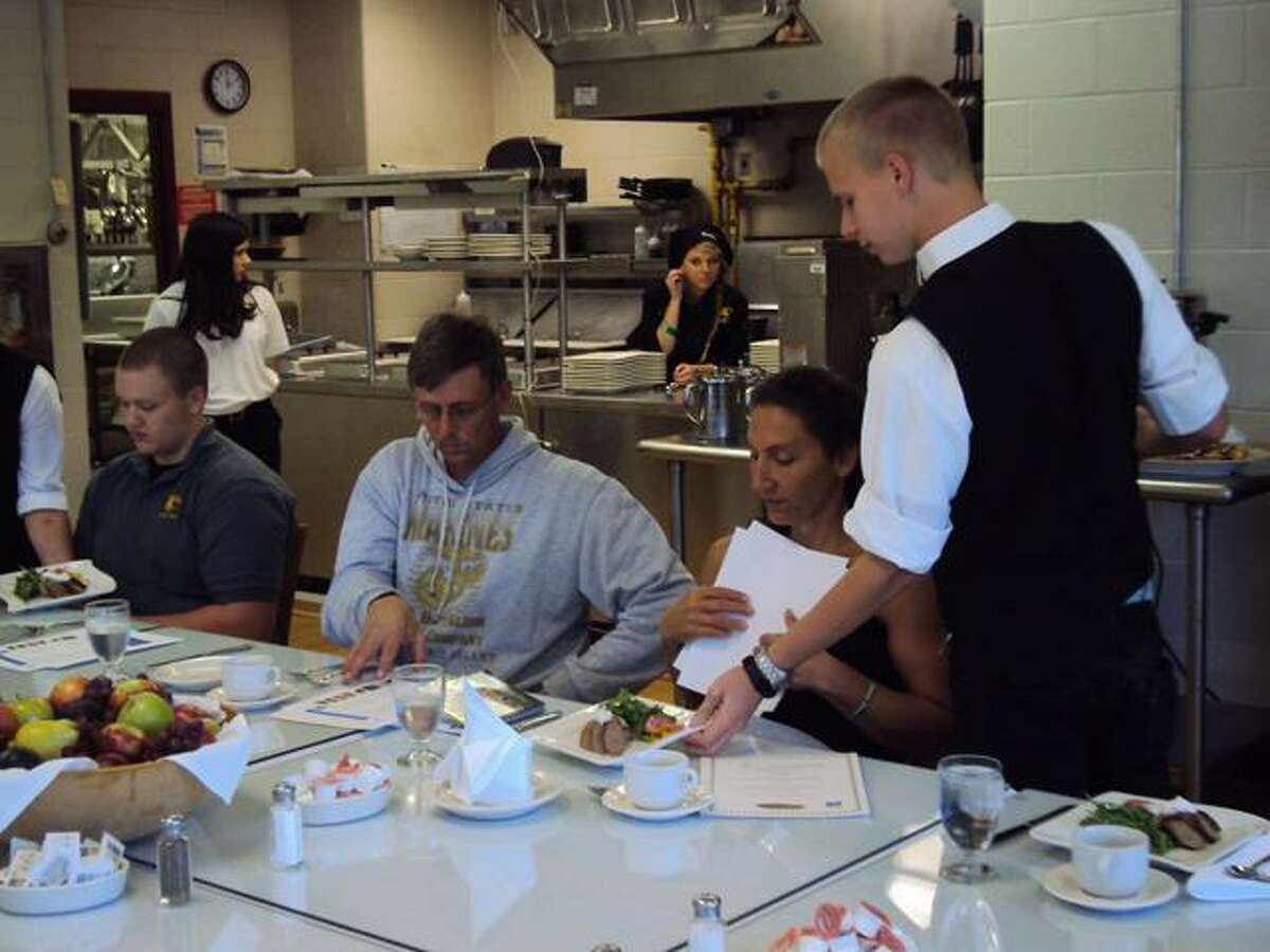 RICKY CAMPBELL/ Register Citizen Students at Oliver Wolcott Tech prepared and served Farm-to-Chef foods to community members Friday.