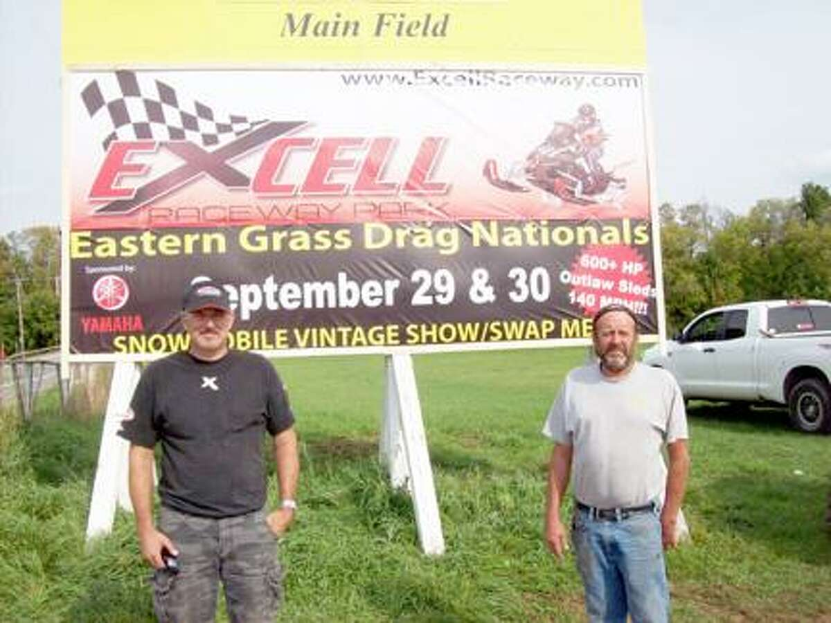 SUBMITTED PHOTO Excell Raceway partners Aaron Excell, left, and Ed Carhart are bringing the thrill of snowmobile racing to Bouckville Sept. 29 and 30 during the Eastern Grass Drag Nationals.