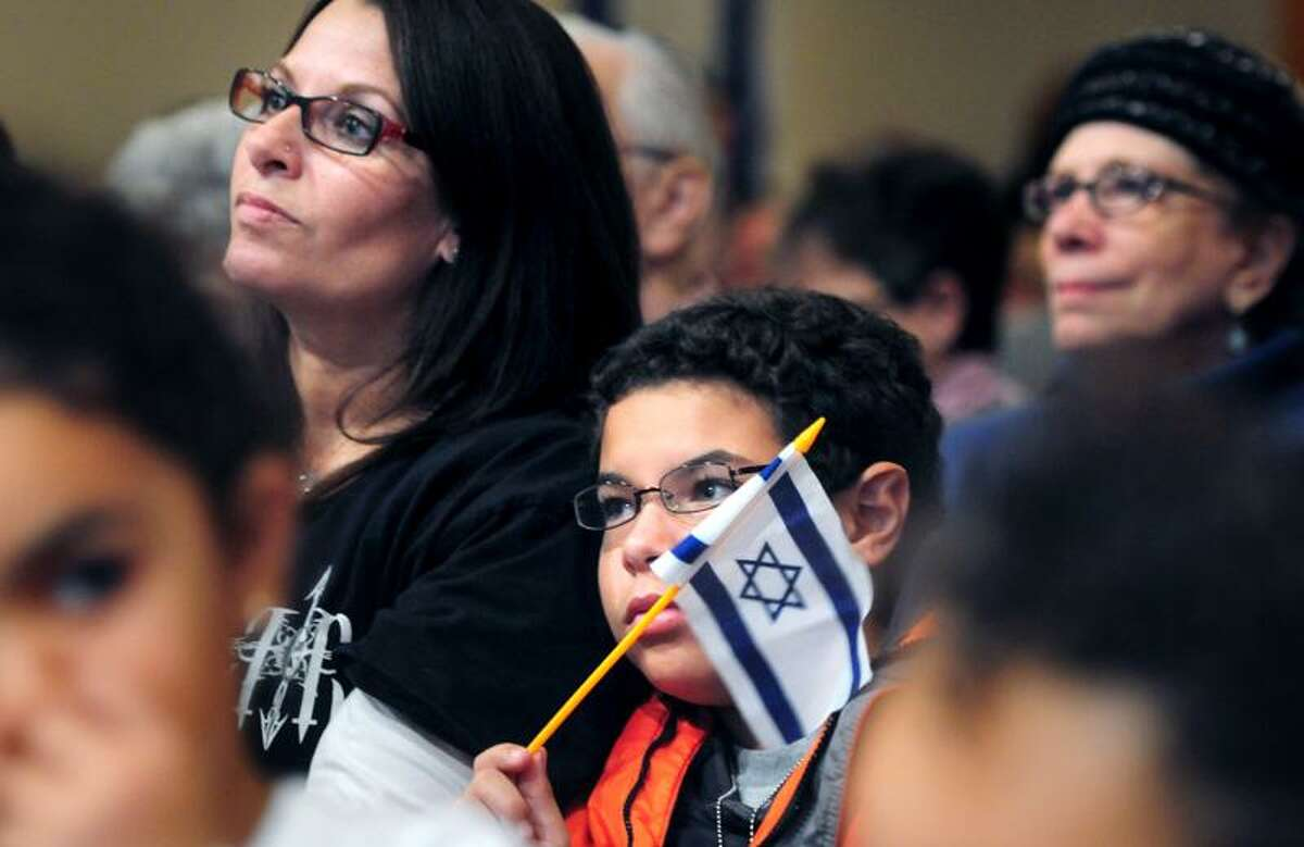Staci Glazier (left) and her son, Jeffery-Zion (right), 11, of New Haven listen to Senator Richard Blumenthal at the rally, We Stand With Israel: Freedom From Fear, at the Jewish Community Center of Greater New Haven in Woodbridge on 11/20/2012.Photo by Arnold Gold/New Haven Register AG0472F