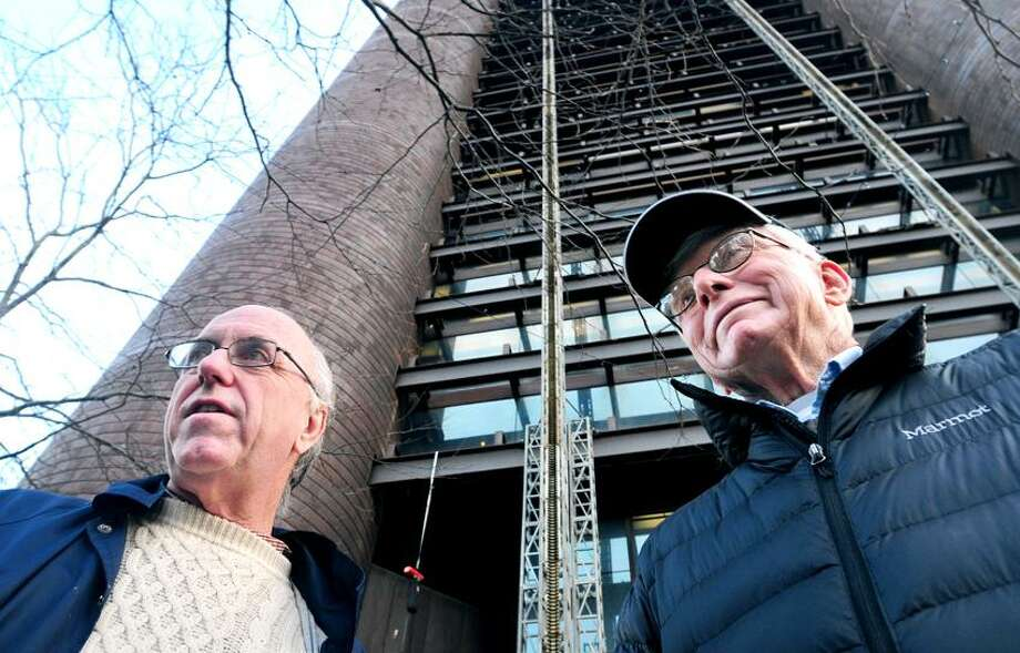 Patrick Carolan (left) of Catholics United delivered a petition to the Knights of Columbus headquarters in New Haven requesting that the organization stop spending money to defeat gay marriage legislation on 11/20/2012.  At right is Traugott Lawler of Hamden.Photo by Arnold Gold/New Haven Register   AG0472F