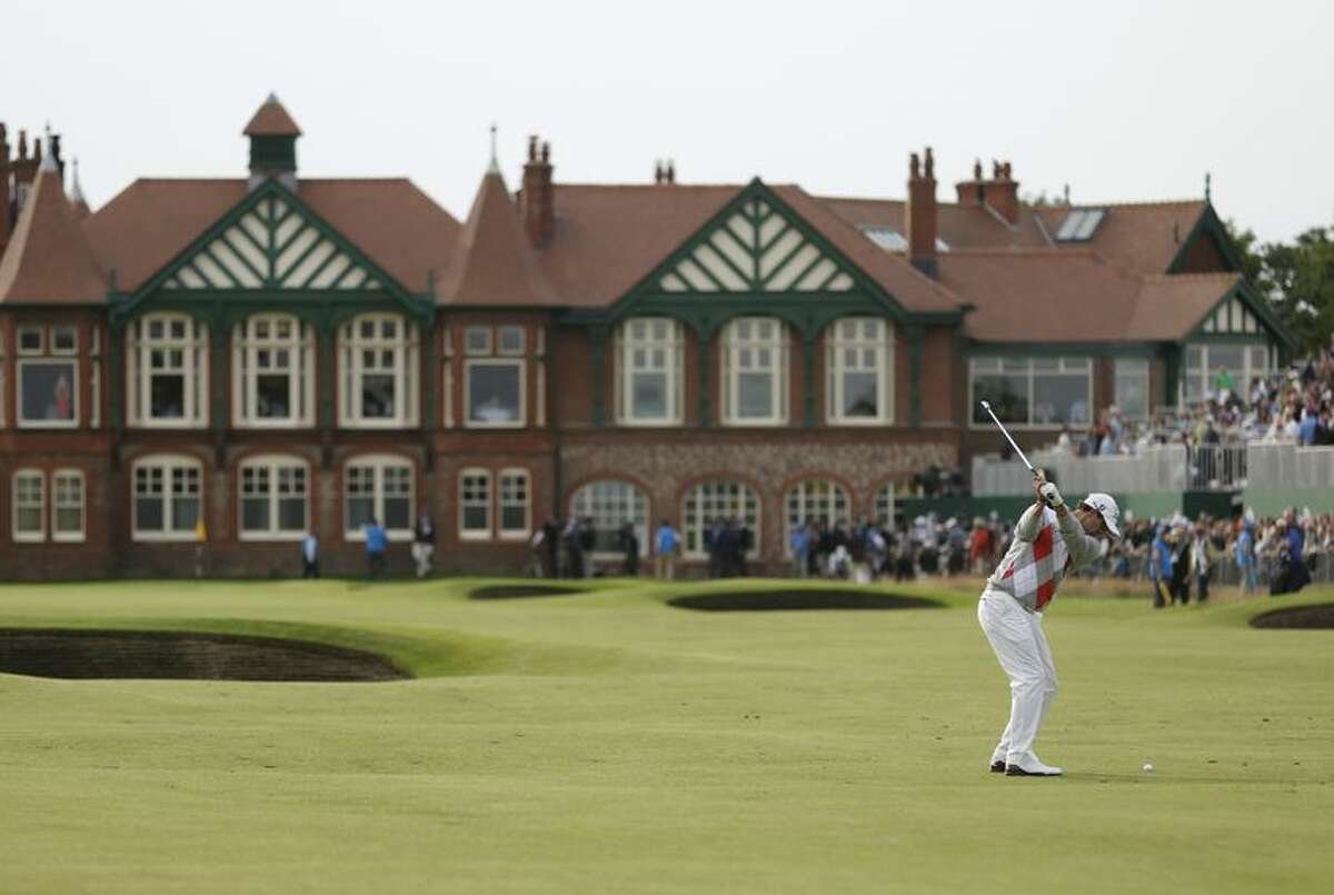 Adam Scott of Australia plays a shot onto the 18th green at Royal Lytham & St Annes golf club during the third round of the British Open Golf Championship, Lytham St Annes, England, Saturday, July 21, 2012. (AP Photo/Peter Morrison)