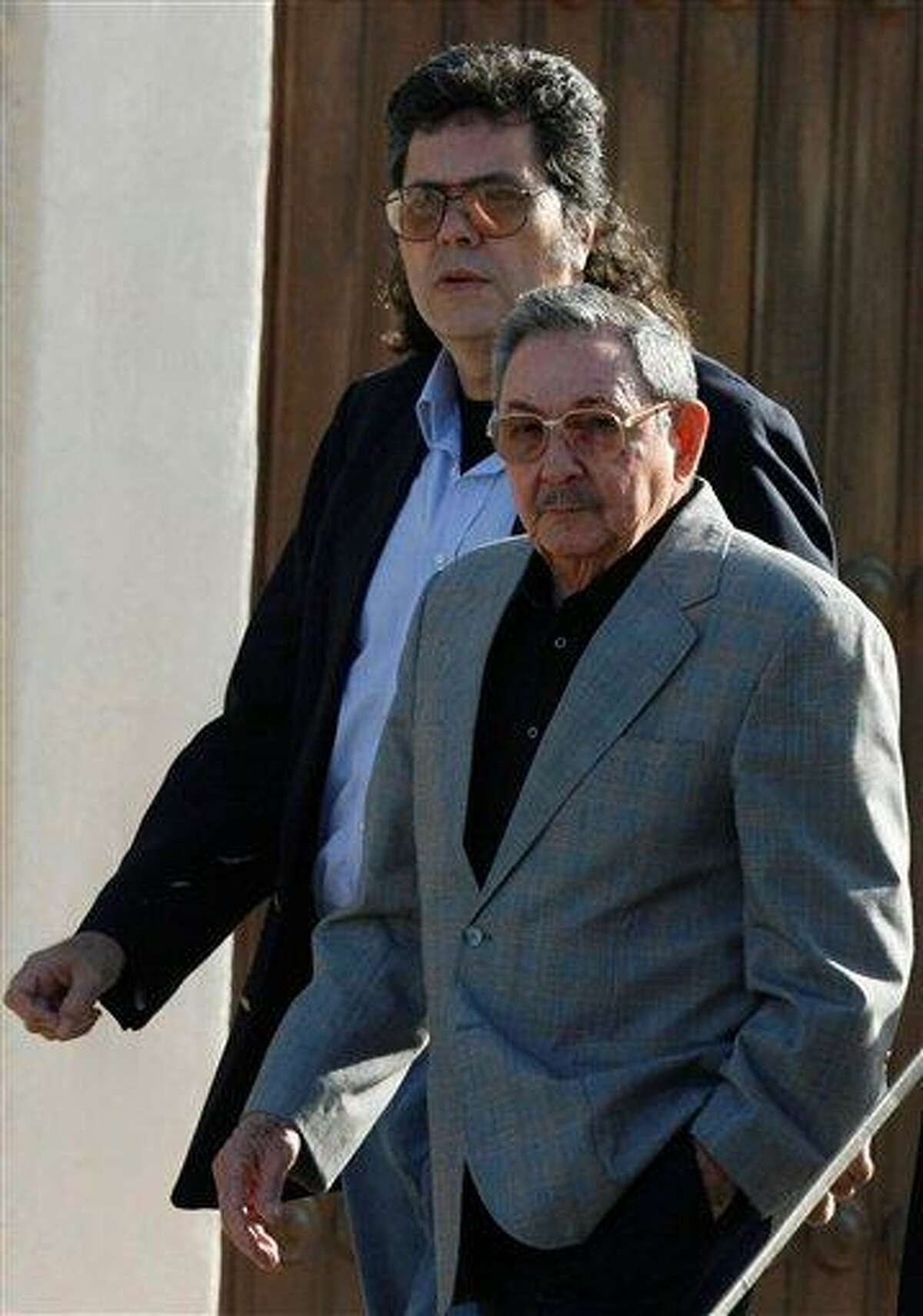 In this 2008 file photo, Cuba's President Raul Castro, right, and Minister of Culture Abel Prieto arrive at the opening ceremony of the International Book Fair in Havana, Cuba. Associated Press