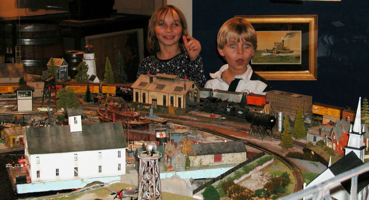 Submitted photo Skye Roberts and Zachary Dobbs discover one of the scavenger items hidden in the layout of the Holiday Train Show exhibit now open at the Connecticut River Museum in Essex.