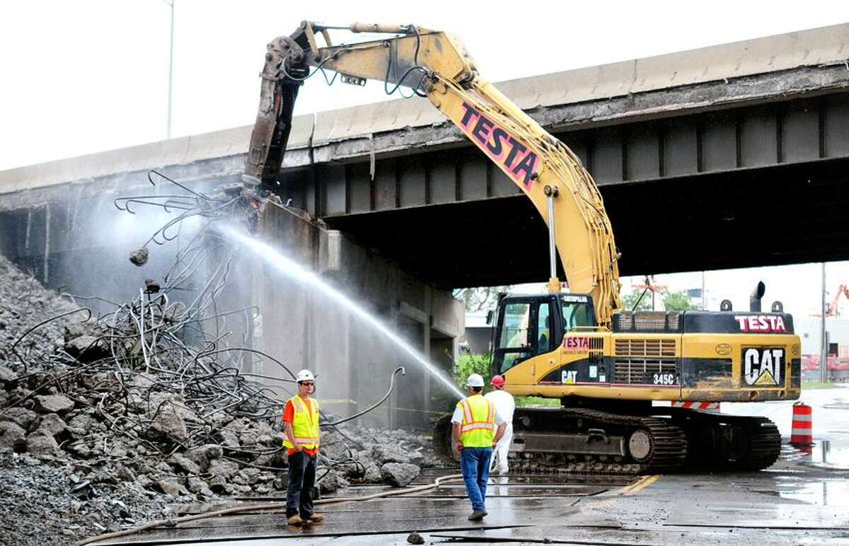 Demolition of the east approach for the old Pearl Harbor Memorial Bridge continues on Stiles St. in New Haven on 7/20/2012. This allows for an approach to the new bridge to be completedPhoto by Arnold Gold/New Haven Register AG0457A