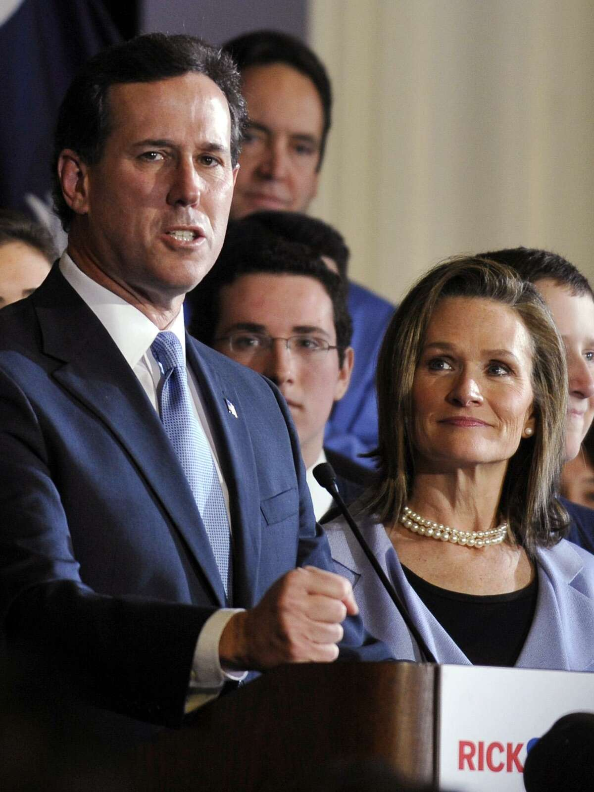 Republican presidential candidate, former Pennsylvania Sen. Rick Santorum, left, speaks as his wife, Karen, looks on during a South Carolina Republican presidential primary night rally at the Citadel, Saturday, Jan. 21, 2012, in Charleston, S.C. Santorum says it's a