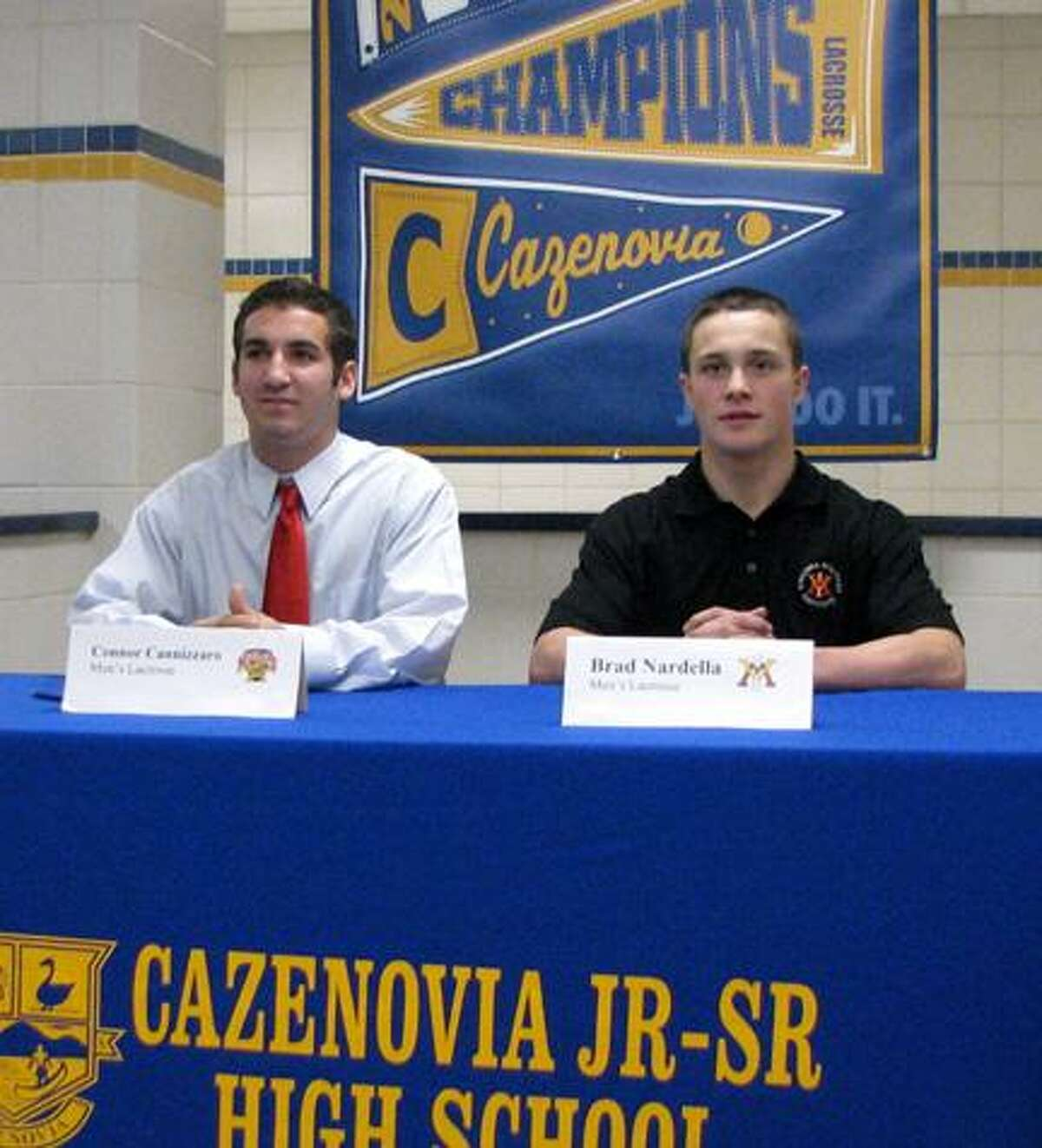 Submitted Photo Cazenovia's Connor Cannizzaro, left, and Brad Nardella signed their letters during a news conference at the high school Monday, November 19, 2012.