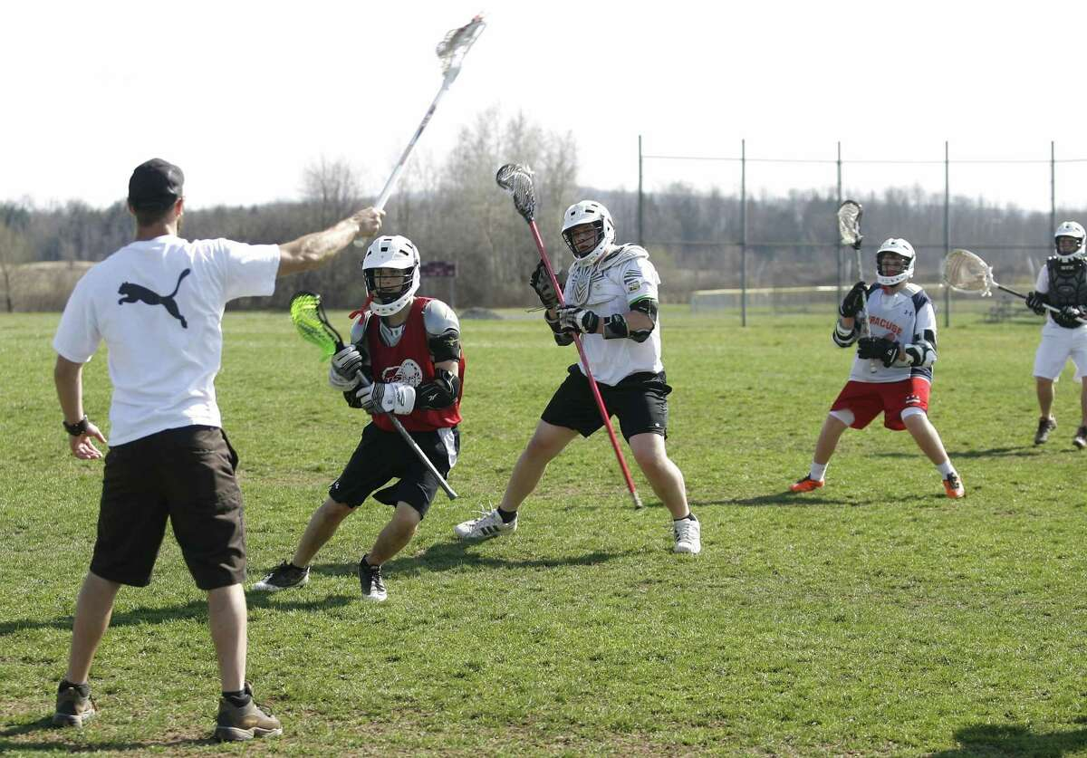 Dispatch Staff Photo by JOHN HAEGER twitter.com/oneidaphoto VVS lax players work on a conditioning drill on Thursday, March 22, 2012 in Verona.
