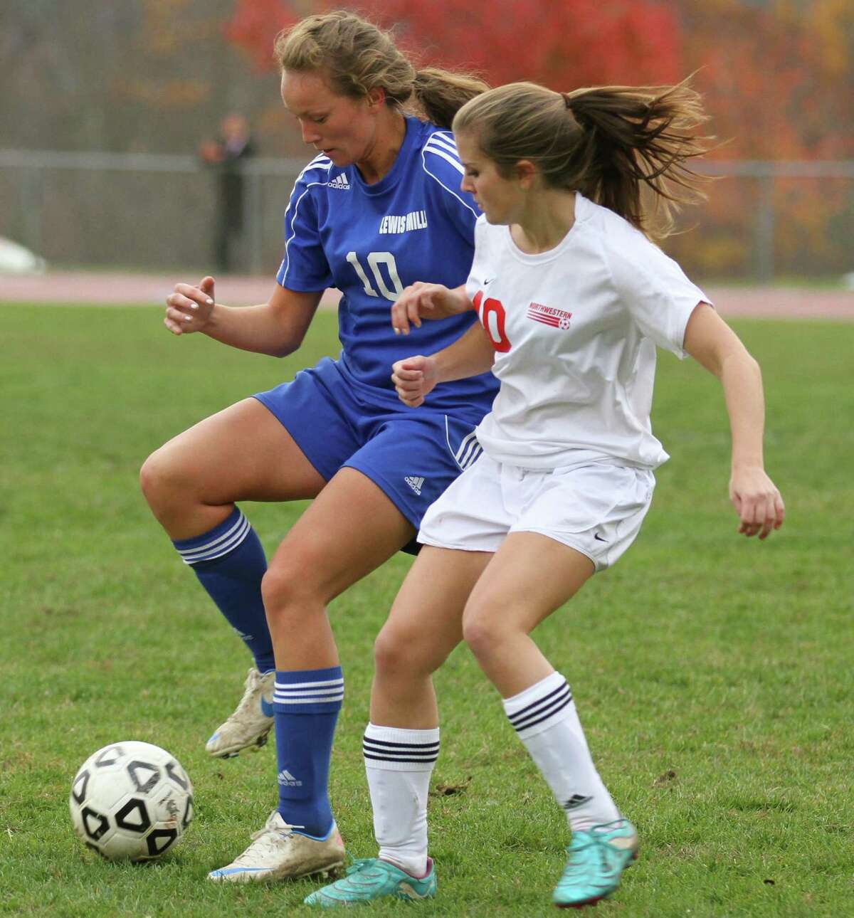 Monique Claude of Lewis Mills and Sam Gagne of Northwestern battle for possession of the ball. Photo by Marianne Killackey/Special to Register Citizen