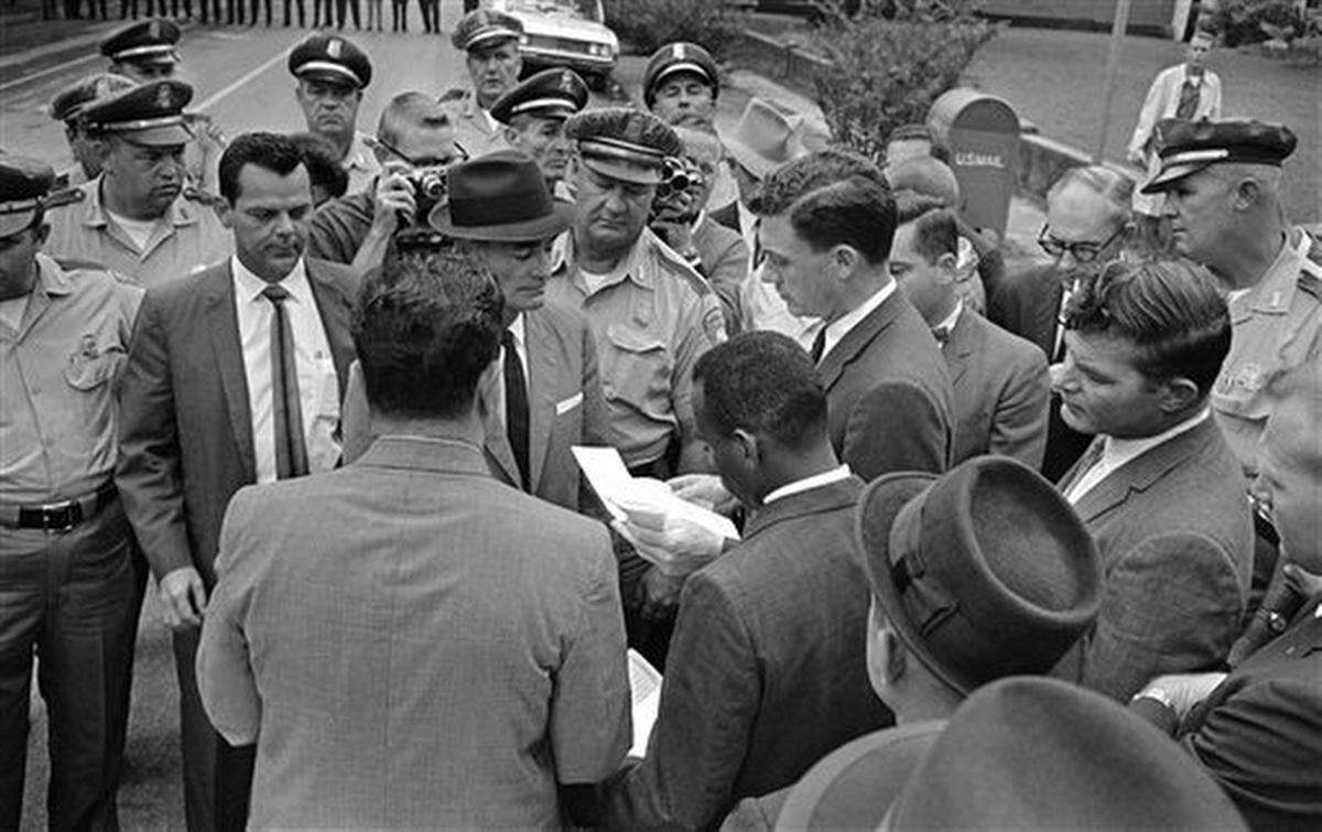 James Meredith looks away from Miss., Lt. Gov. Paul B. Johnson, Jr., as Johnson tells him he cannot enter the University of Mississippi in Oxford, Sept. 26, 1962. Mississippi Highway patrolmen blocked all entrances to the Ole Miss campus in Oxford and moved from side to side in Meredith's way, blocking him and federal marshals trying to get Meredith onto the campus. (AP Photo/Jim Bourdier)