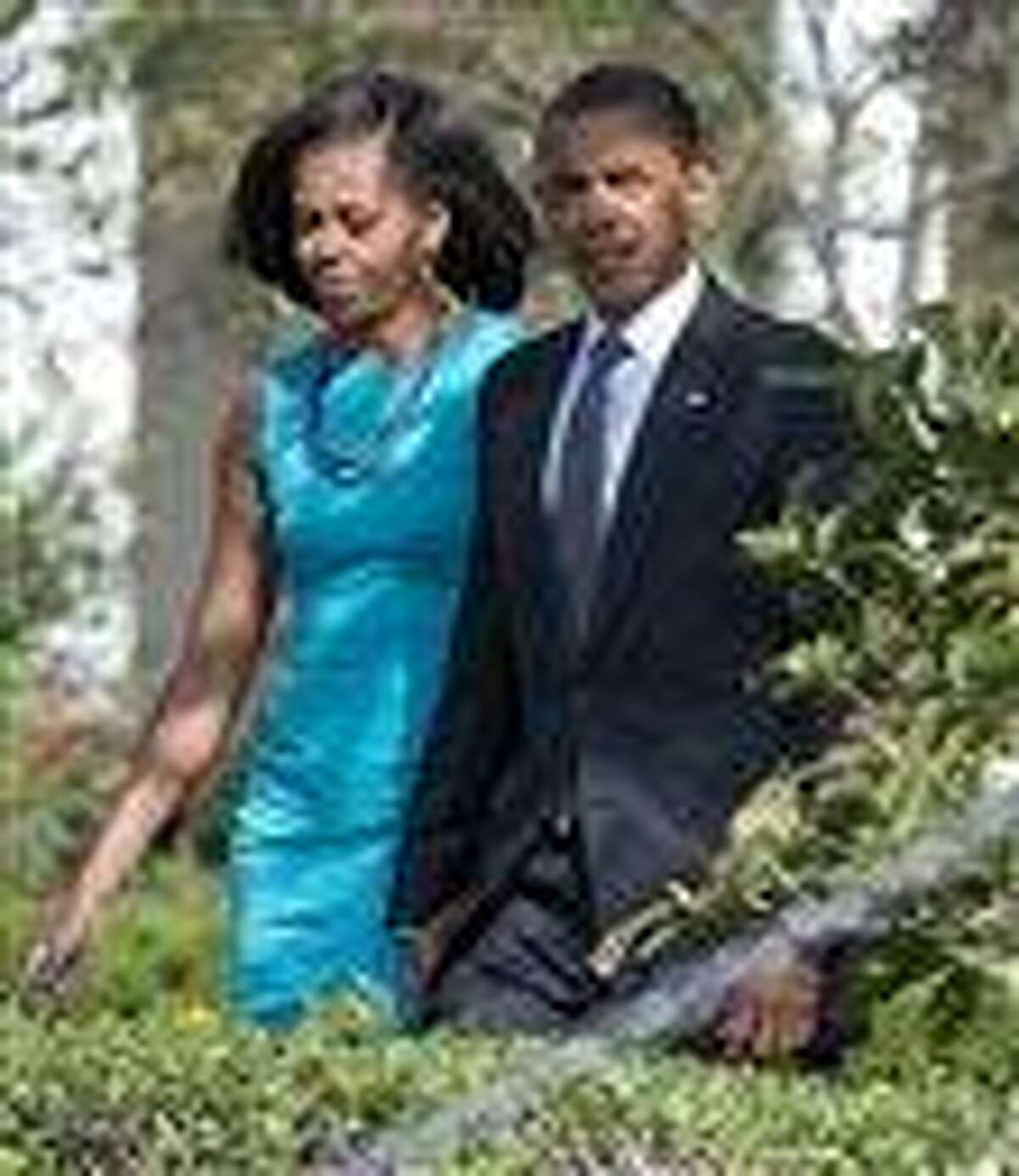 President Barack Obama and first lady Michelle walk to the South Lawn of the White House in Washington.