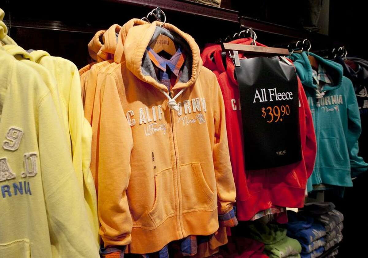 Hooded fleece jackets are on sale at Who.A.U in New York. (Associated Press)