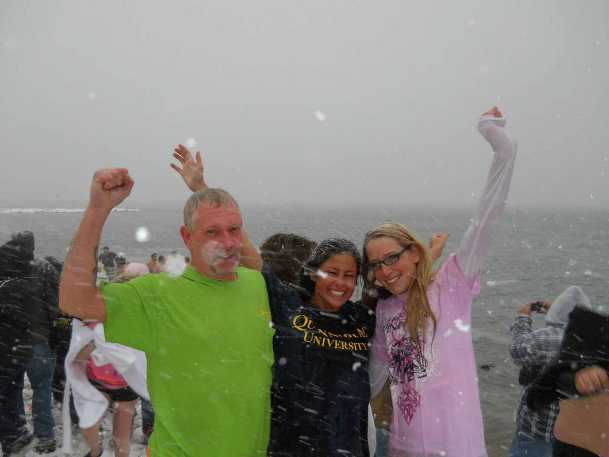 Keith Bailey, his daughter, Jackee Bailey, and friend Natalie Perrotti take the Icy Plunge for the Cure in West Haven Saturday morning, in the middle of a monster snowstorm. Contributed photo/Keith Bailey
