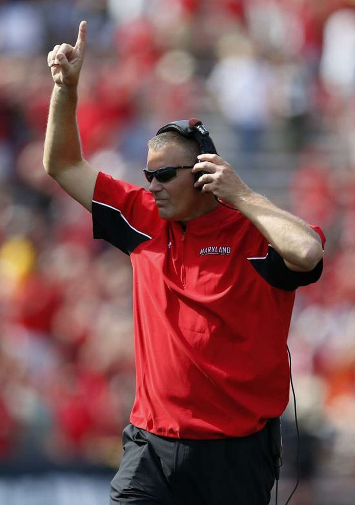 This Sept. 15 file photo shows Maryland head coach Randy Edsall reacts after his team scored a touchdown in the second half of an NCAA college football game against UConn. in College Park, Md. Maryland is set to announce it is joining the Big Ten Monday in 2014. Associated Press.