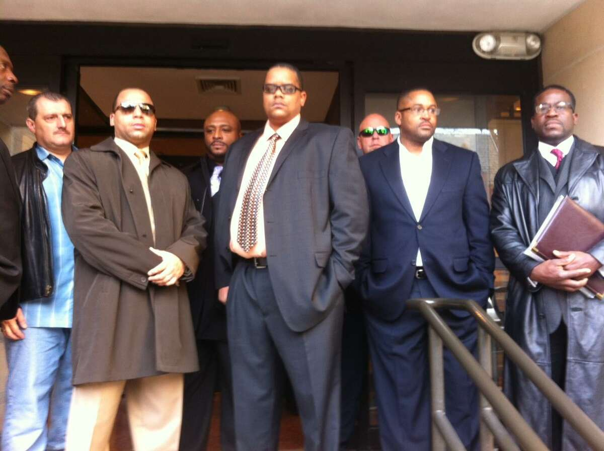 New Haven police officers who claim they were illegally denied promotion stand outside of Superior Court photo by William Kaempffer