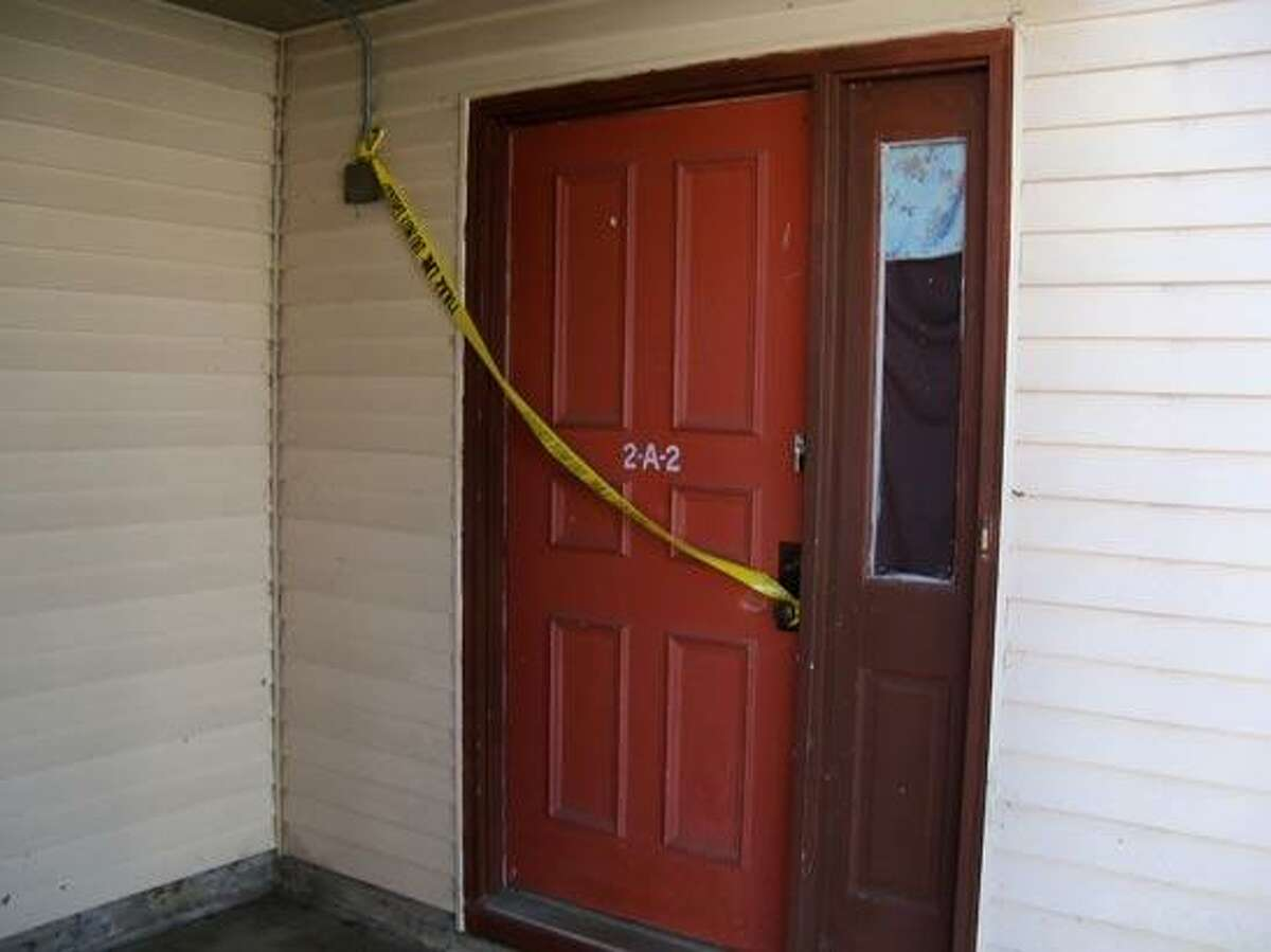 Police tape blocks off the door of an apparent shooting in Simbury. Photo by Scot Allyn/Register Citizen Staff