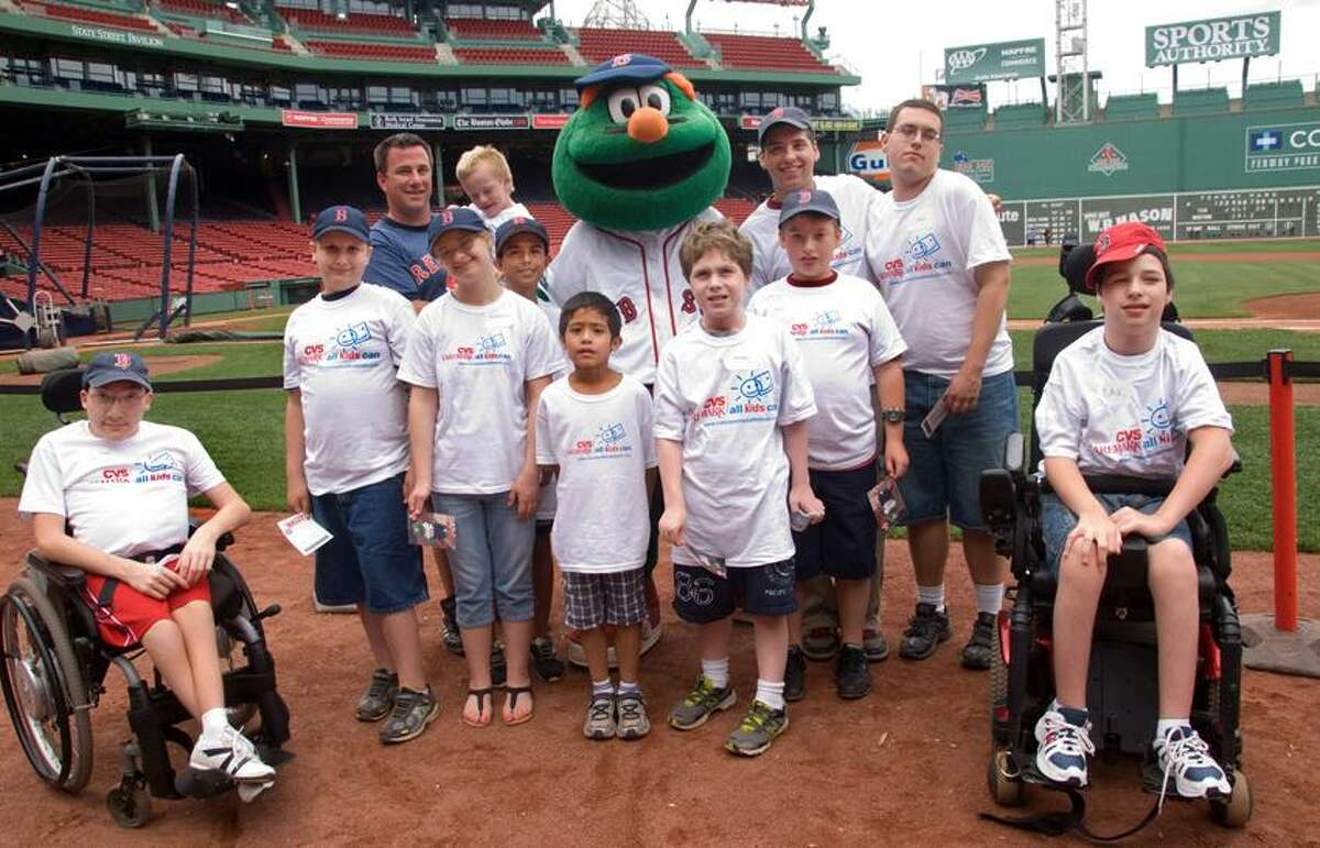 """Members of the Cheshire Challenger Little League meet Boston Red Sox mascot """"Wally"""" during Friday's CVS Caremark All Kids Baseball Camp at Fenway Park. (Contributed photo)"""