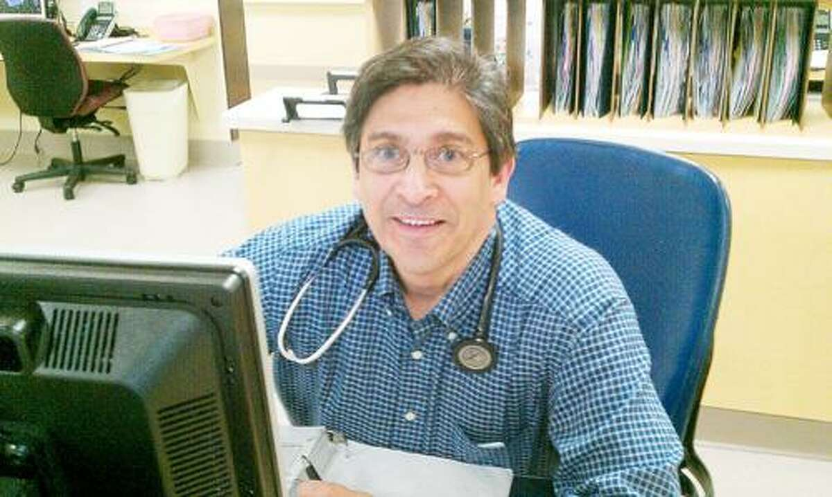 Dispatch Staff Photo by CAITLIN TRAYNOR Dr. Anthony Dasaro sits at a desk at Oneida Healthcare.