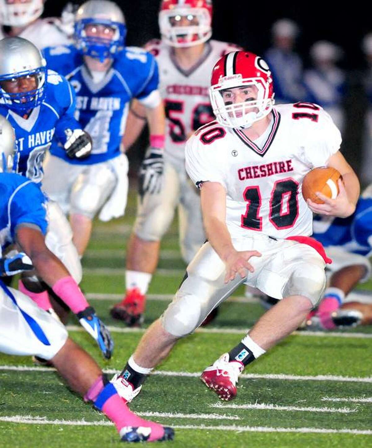 Cheshire quarterback Vincent Sansone, right, runs against West Haven in the first half of a regular-season game. Cheshire plays at Southington on Thursday at 10:30 a.m. Photo by Arnold Gold/New Haven Register.