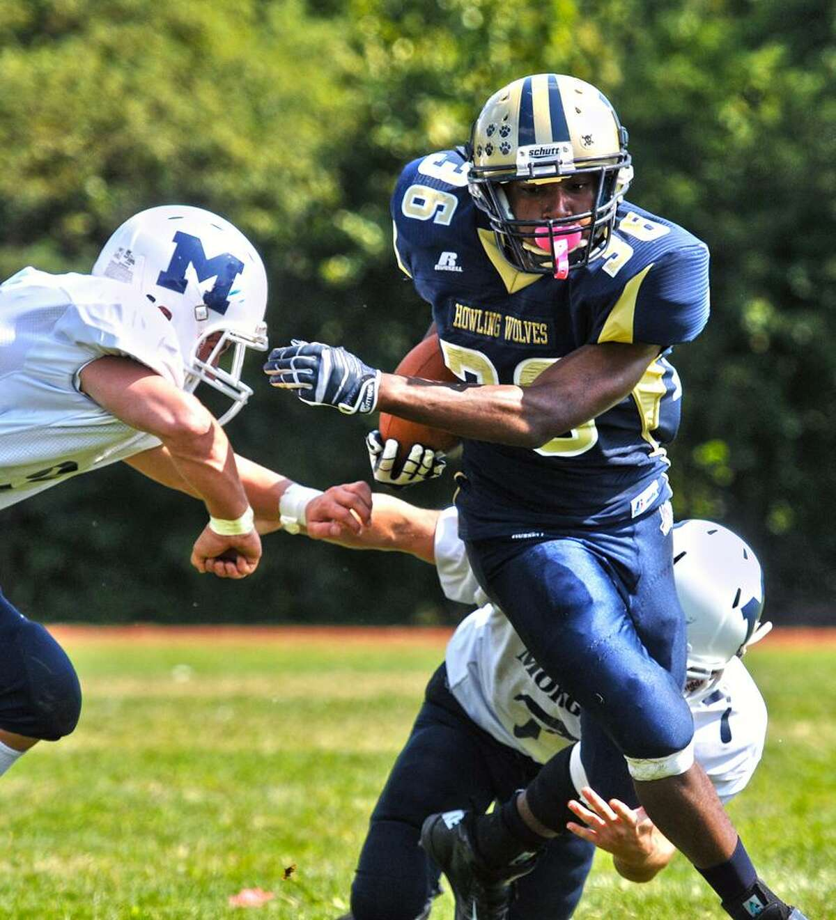 Akeem Berry, center, and the Hyde football team face North Branford Wednesday night in a Pequot Conference showdown of undefeated teams. Photo Peter Casolino/New Haven Register.