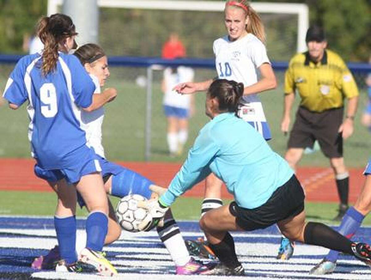 Dispatch Staff Photo by JOHN HAEGER (Twitter.com/OneidaPhoto) Whitesboro's keeper Emilie Mull makes a save on a shot off the foot of Camden's Jenna Sherwood (8) as Whitesboro's Julie Britt (9) and Camden's Michaela Soules (10) back up the play in the first half of their match on Thursday, Sept. 20, 2012 in Camden.