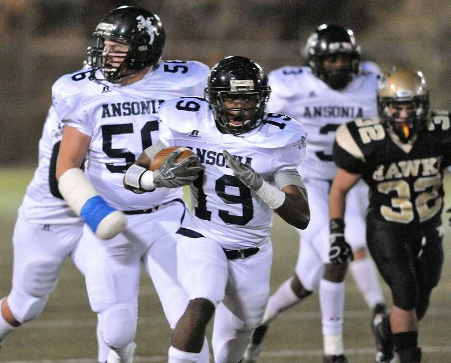 Just like everyone was chasing Ansonia's Hazekiah Duncan on this interception return for a touchdown against Woodland in the NVL championship game, everyone in the Class S division is chasing the Chargers, the likely top seed when the pairings become official on Friday. Peter Casolino/New Haven Register.