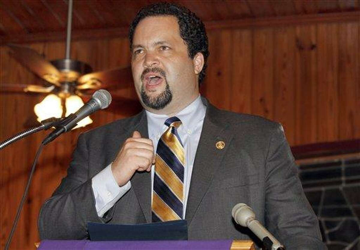 Ben Jealous of the NAACP talks to a congregation of supporters Tuesday in Sanford, Fla., in protest against the lack of prosecution in reference to an unarmed black teenager, who was shot to death by a neighborhood watch captain in Florida. Associated Press