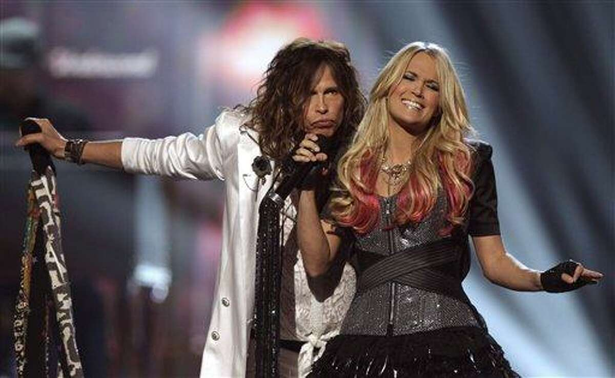 FILE - In this April 3, 2011 file photo, singers Steven Tyler and Carrie Underwood perform at the 46th Annual Academy of Country Music Awards in Las Vegas. Tyler and Carrie Underwood are teaming up for a special CMT Crossroads the night before the Super Bowl.