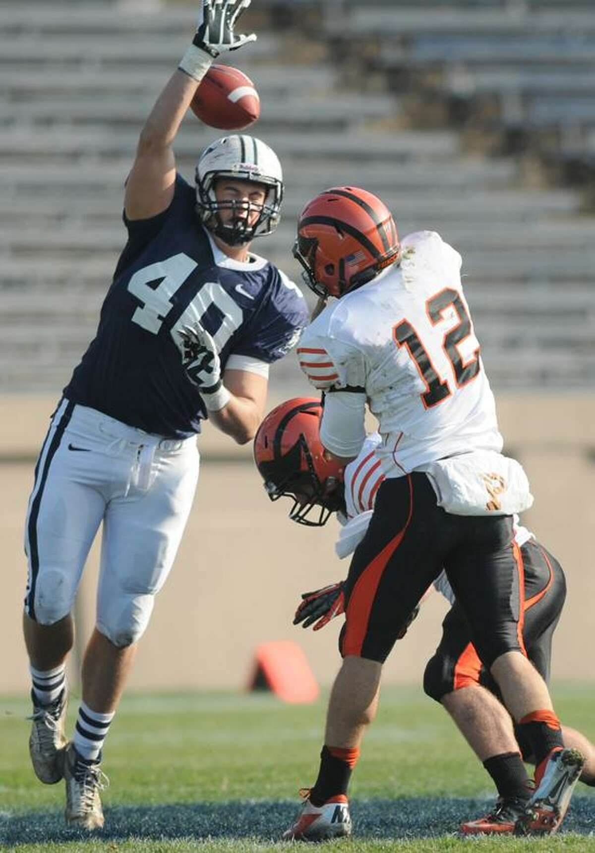 Beau Palin tries to knock down a pass by Princeton quarterback Connor Michelsen at Yale Bowl on Saturday, November 10, 2012. (Peter Hvizdak/New Haven Register)