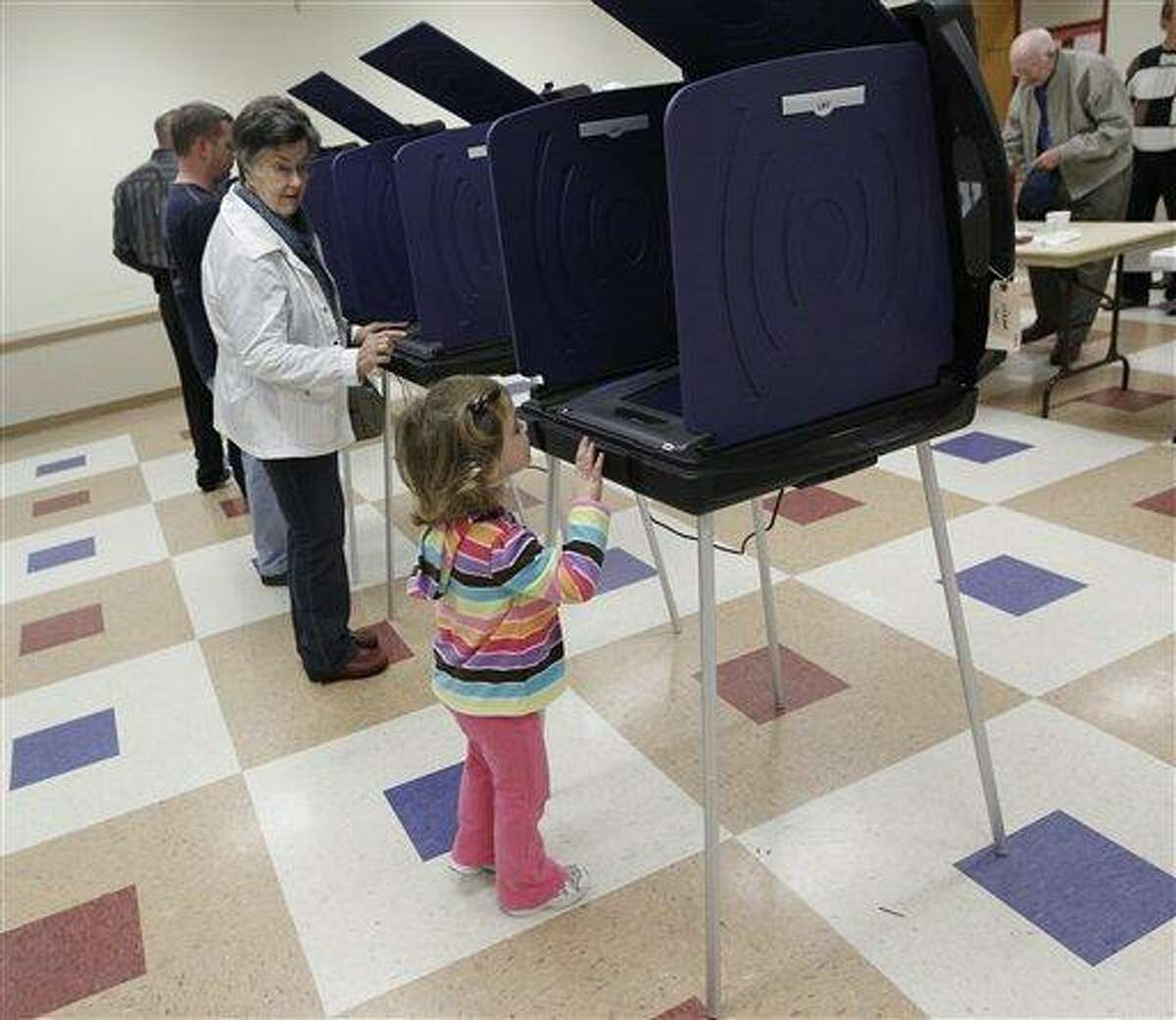 Mary Michaelis, left, prepares to vote in the South Carolina Republican presidential primary as her granddaughter, Reese Ward, 3, looks over a neighboring voting booth in Columbia, S.C., Saturday. Associated Press