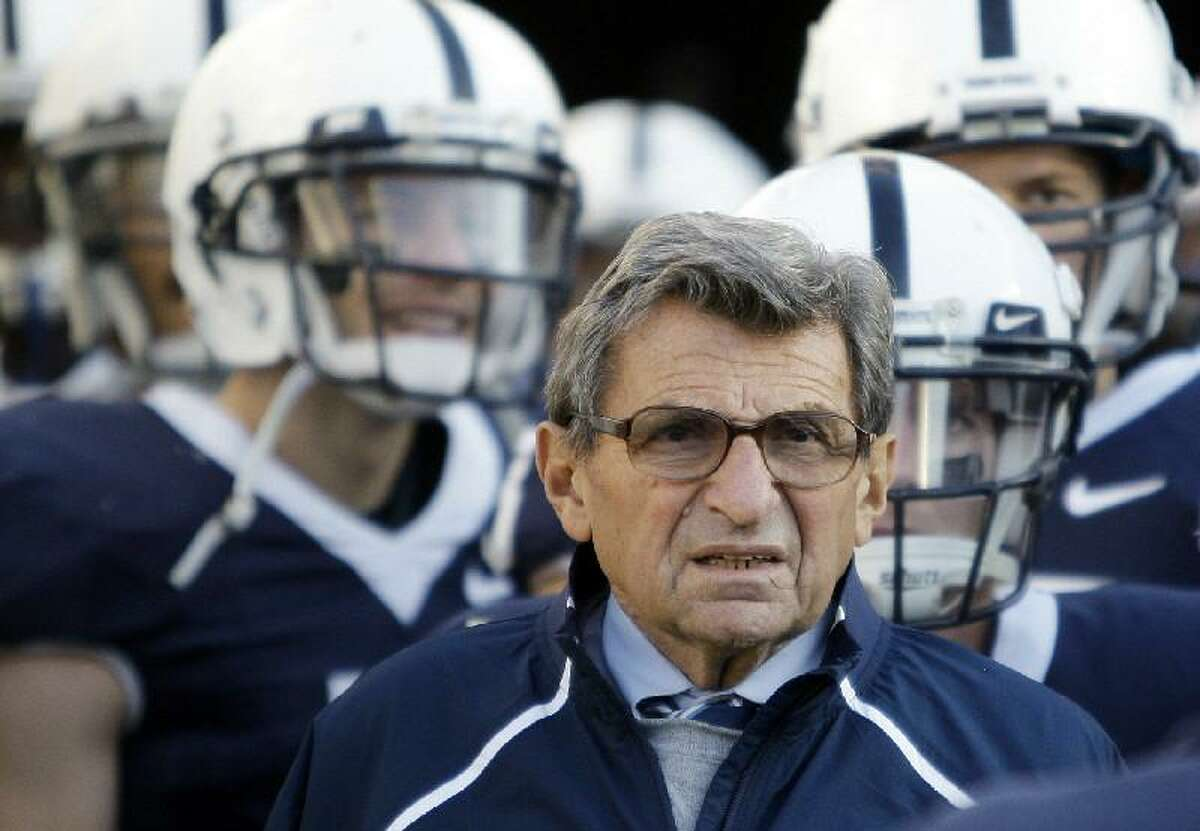 ASSOCIATED PRESS In this Nov. 7, 2009, file photo, Penn State Coach Joe Paterno stands with his players before taking the field for a game against Ohio State in State College, Pa. Multiple reports say the former Penn State coach, who is battling lung cancer, has died after experiencing health complications. The 85-year-old Paterno had been in the hospital since Jan. 13 for observation for what his family had called minor complications from cancer treatments.