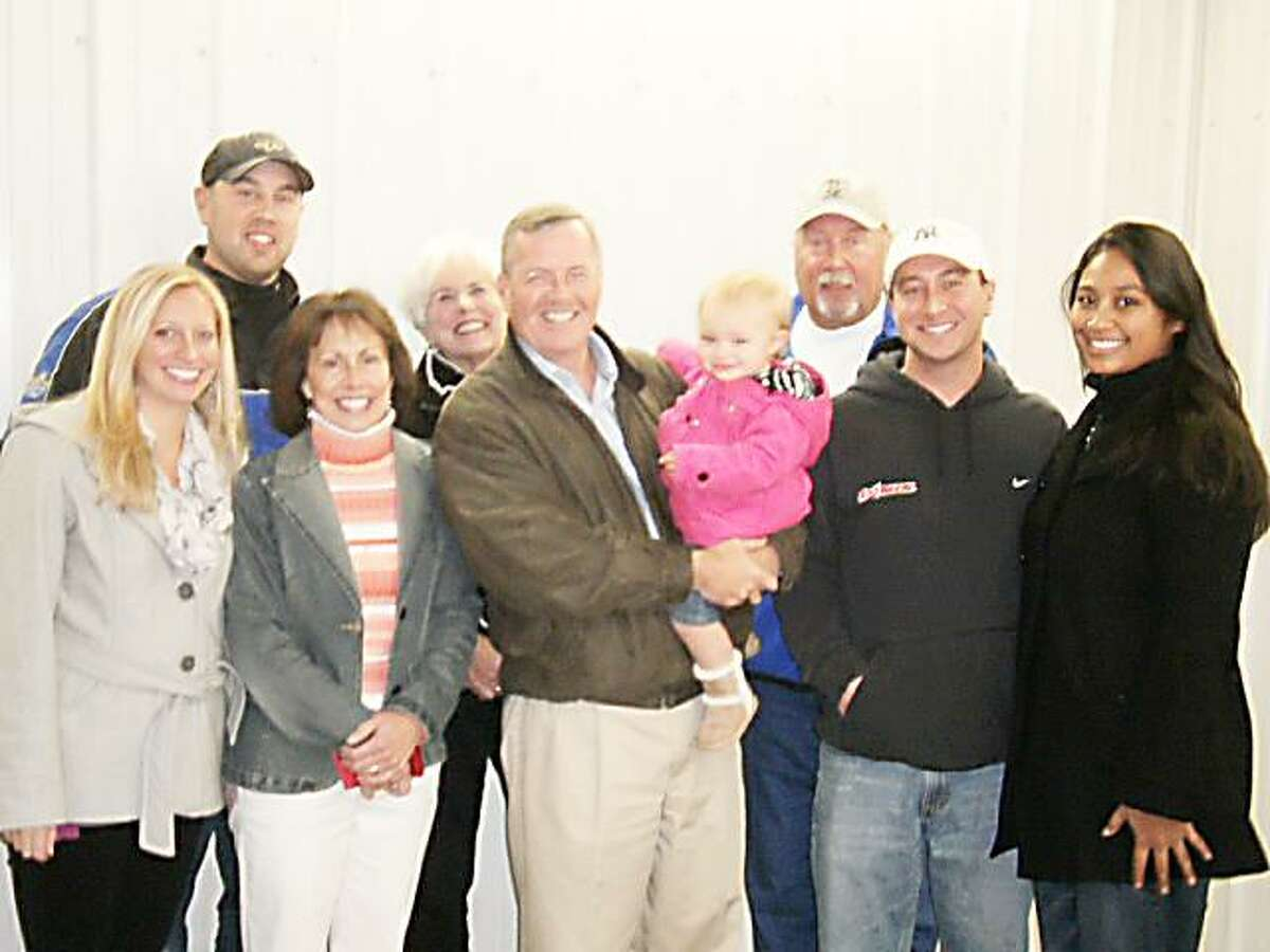 Photo Courtesy HANK LEO Extreem Car Wash employees and family attend a ribbon cutting at the Oneida business.