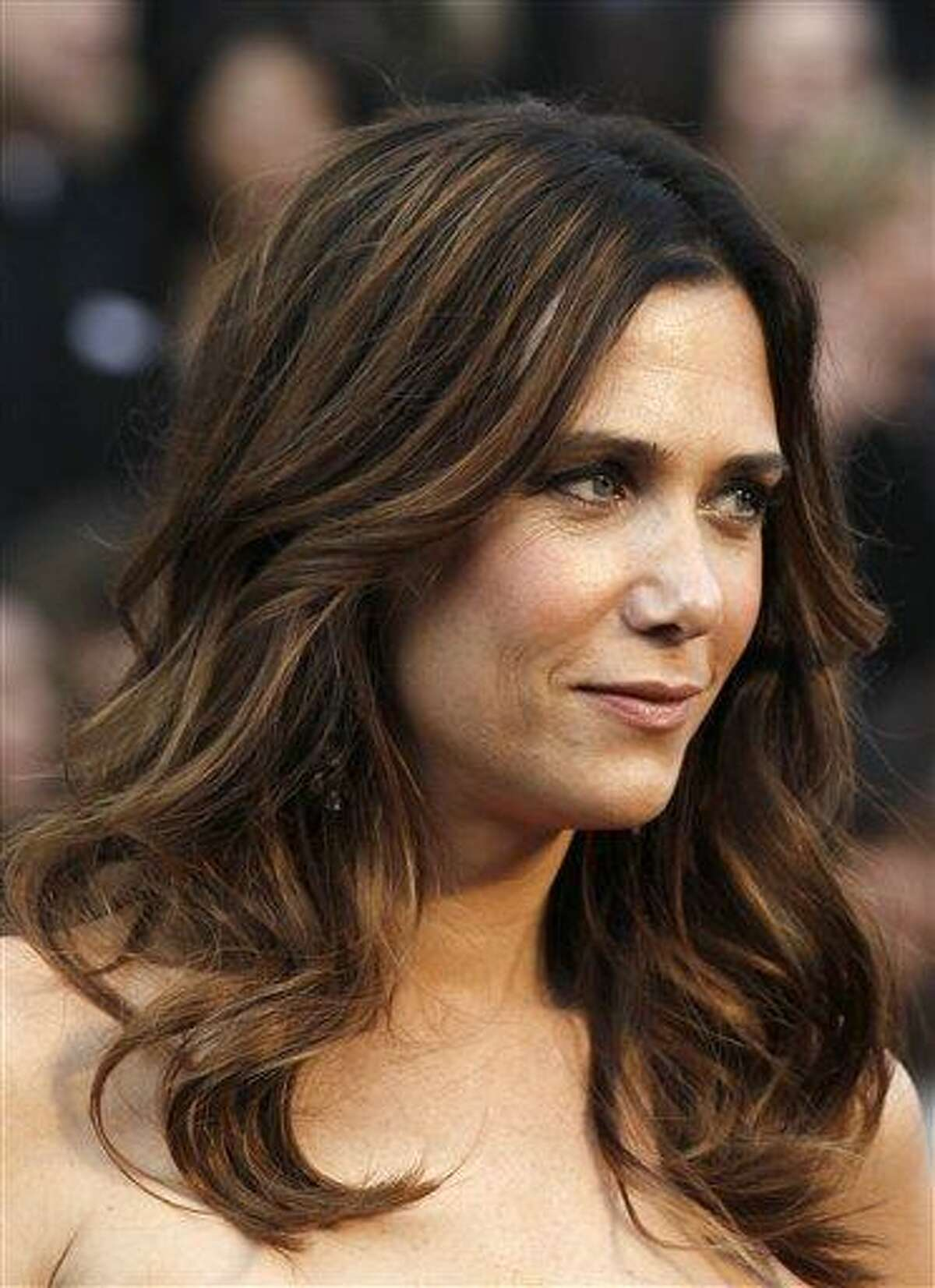 Kristen Wiig arrives before the 84th Academy Awards on in this February 2012 file photo taken in the Hollywood section of Los Angeles. Wiig got a musical sendoff on the season finale of
