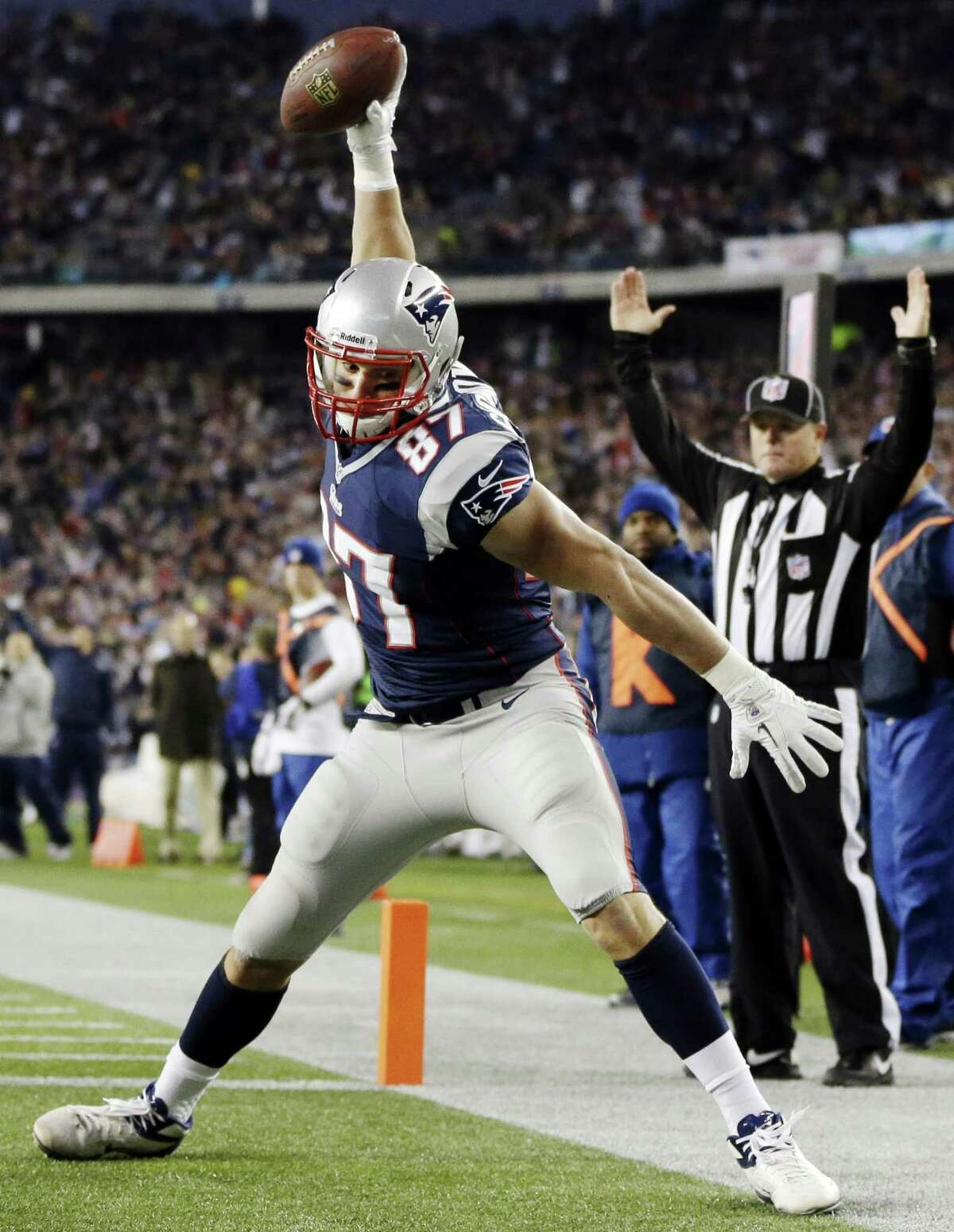 New England Patriots tight end Rob Gronkowski spikes the ball after his touchdown catch against the Indianapolis Colts in the first quarter at Gillette Stadium in Foxborough, Mass., Sunday, Nov. 18, 2012. Photo by Associated Press