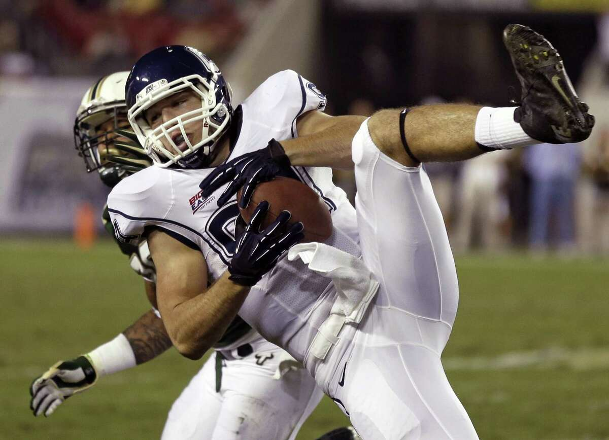 Connecticut tight end Ryan Griffin makes a diving catch from quarterback Chandler Whitmer against South Florida on Saturday, Nov. 3, 2012. Photo by Associated Press