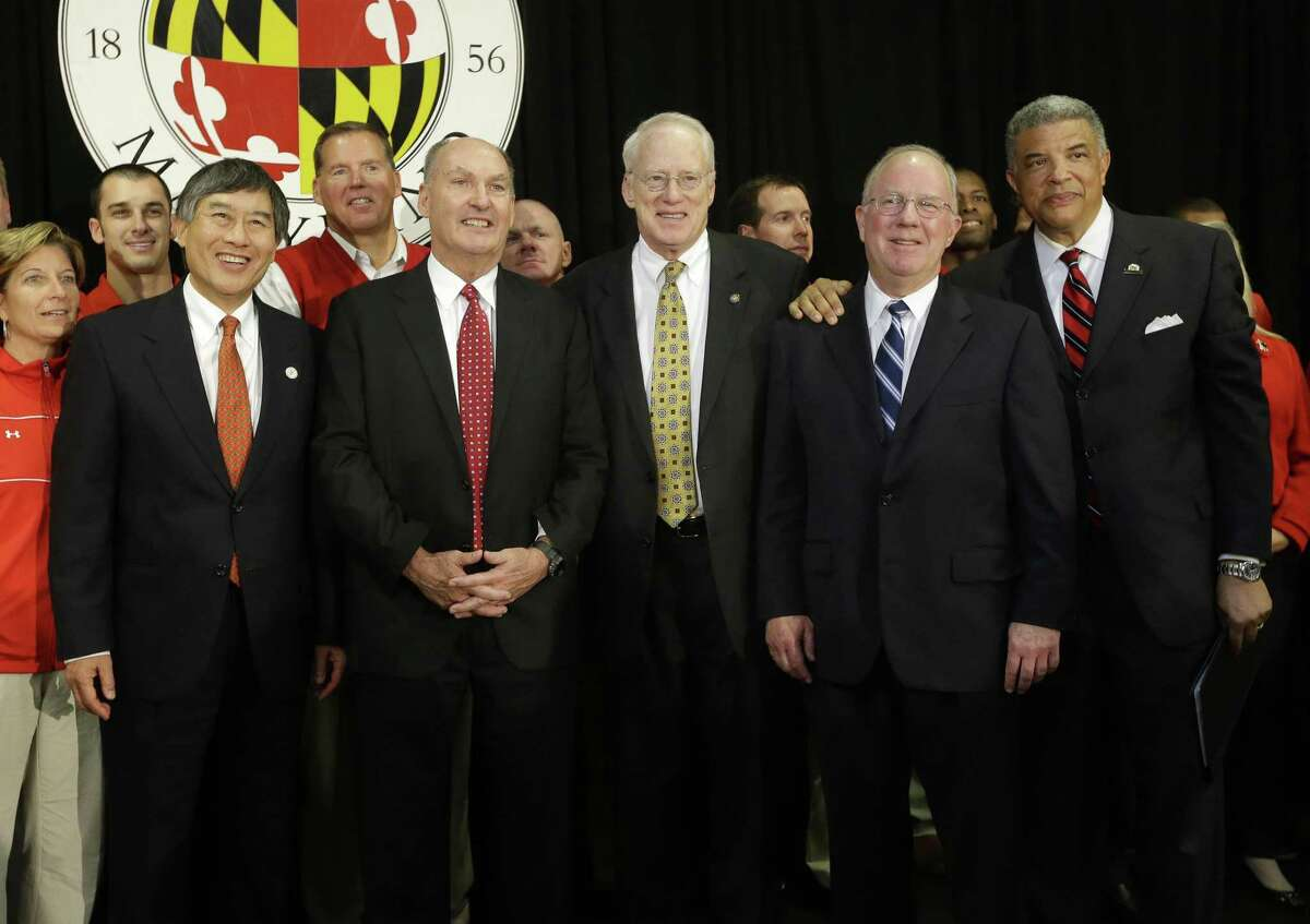 University of Maryland President Wallace Loh, from left, Big Ten Commissioner James Delany, University System of Maryland Chancellor Brit Kirwin, University System of Maryland Board of Regents Chairman James Shea and Maryland Athletic Director Kevin Anderson pose after a news conference to announce Maryland's decision to move to the Big Ten in College Park, Md., Monday.