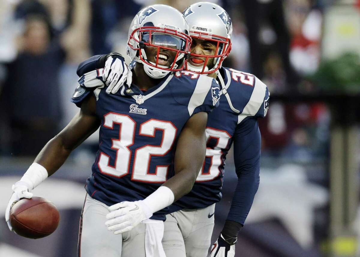 New England Patriots cornerback Devin McCourty (32) celebrates with safety Steve Gregory (28) after he intercepted a pass in the end zone against the Buffalo Bills in the last minutes of an NFL football game at Gillette Stadium in Foxborough, Mass. Sunday, Nov. 11, 2012. The Patriots won 37-31. (AP Photo/Elise Amendola)
